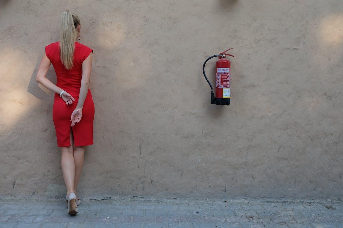 Woman Facing Wall