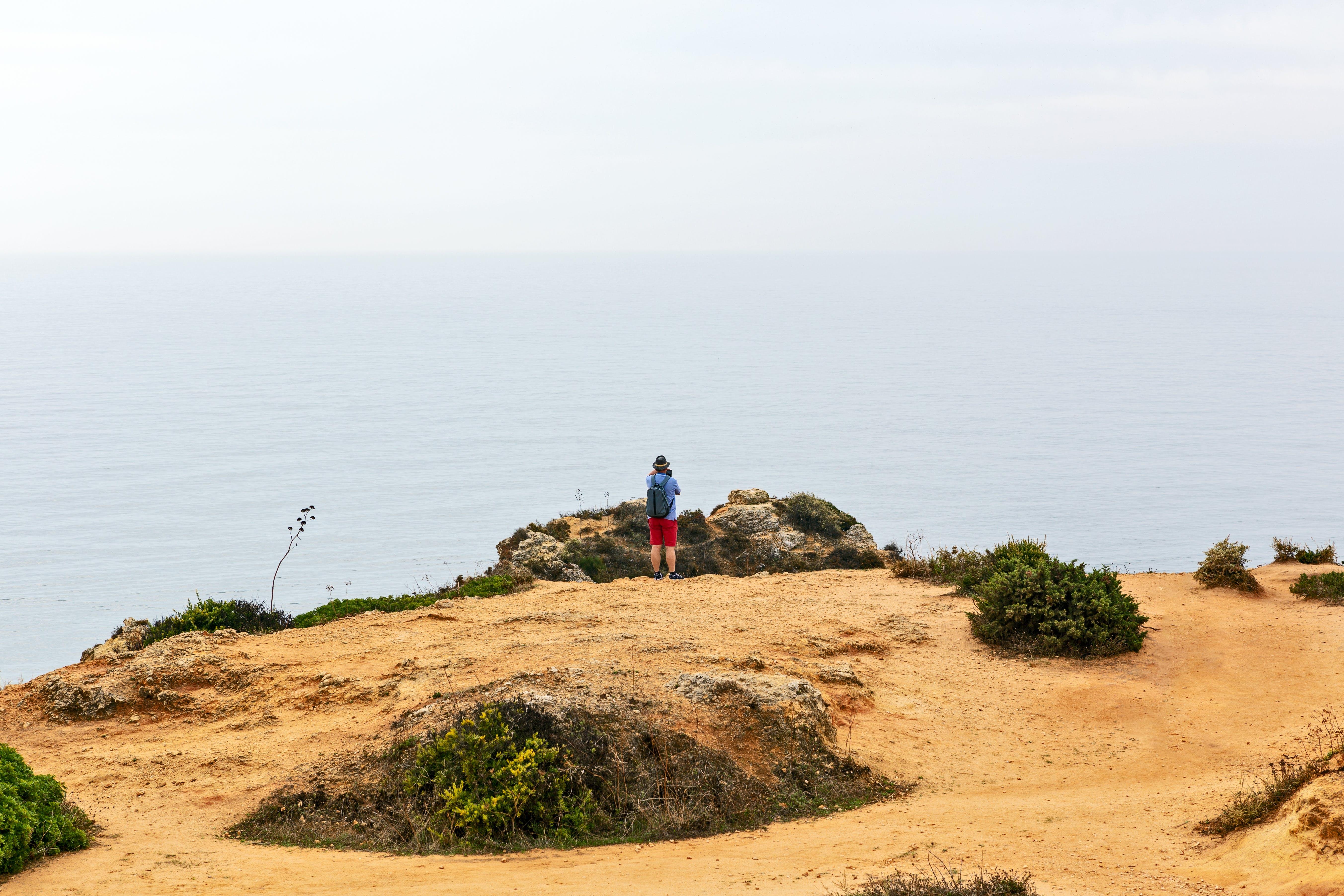 Person Standing Near Rocks