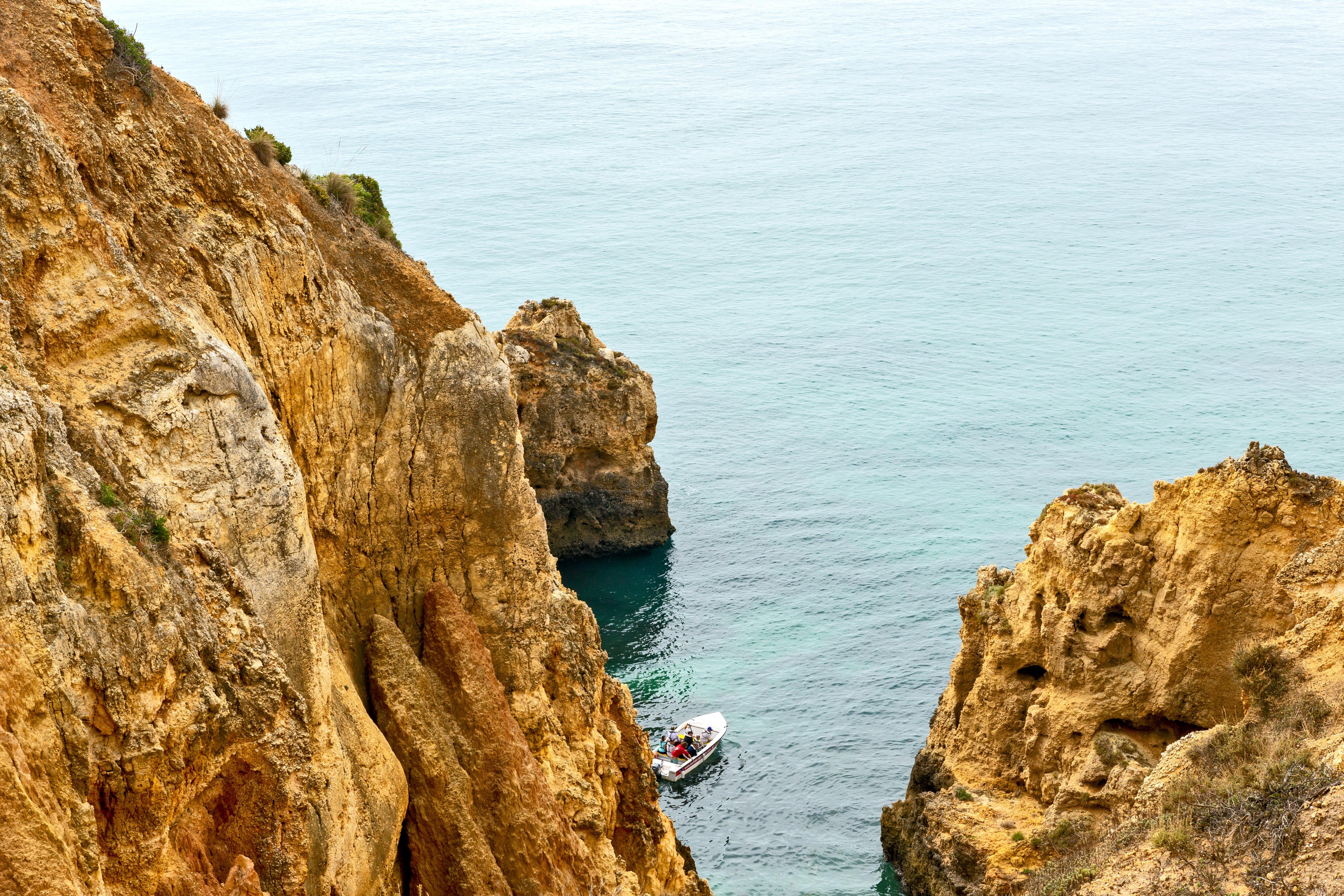 White Boat Near Cliff
