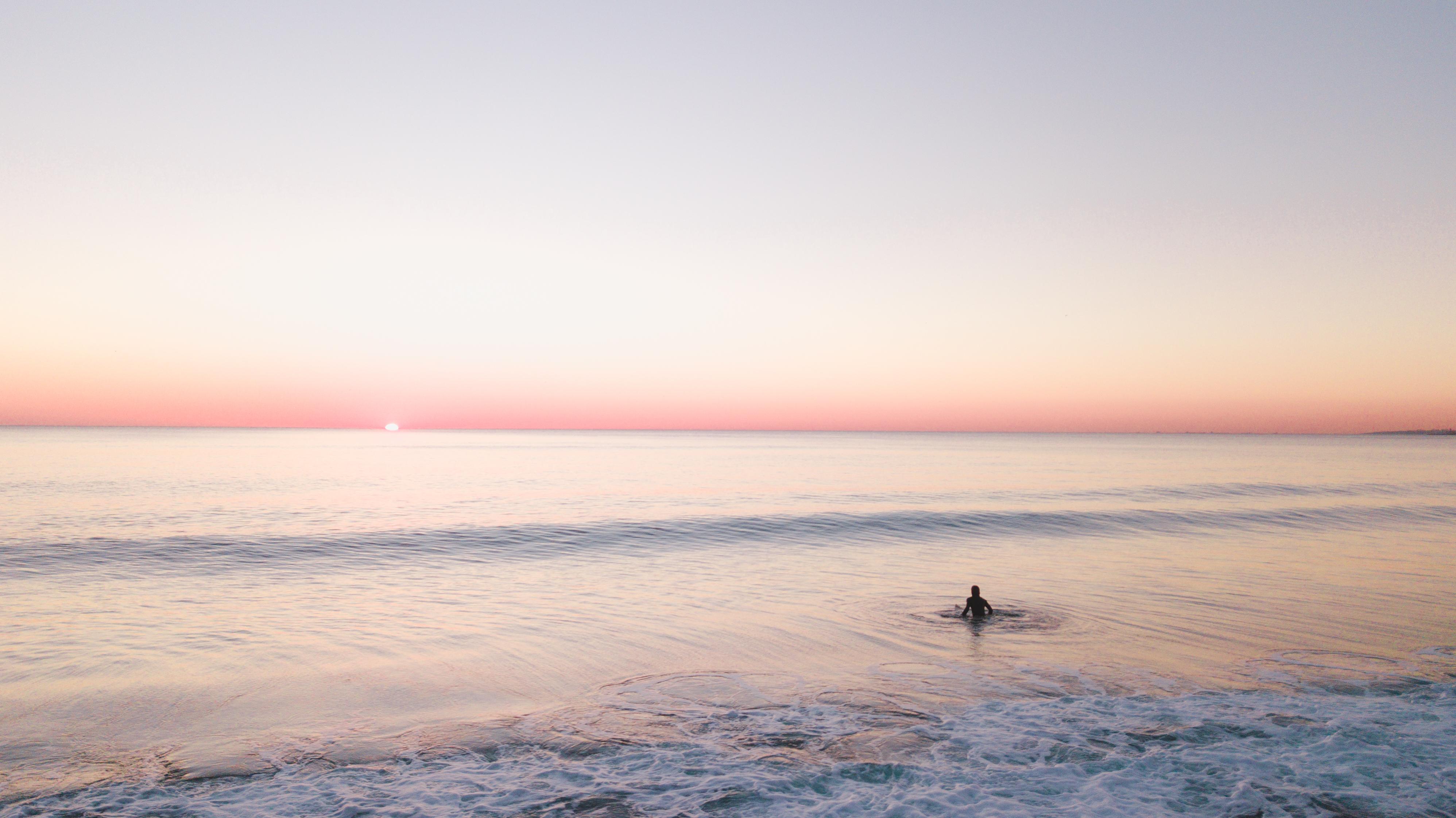 Person Swimming Alone In The Sea