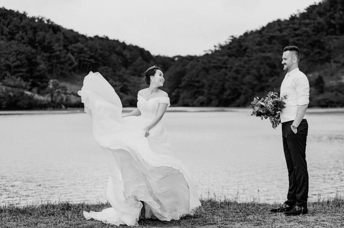 Monochrome Photo of Woman Wearing Wedding Gown
