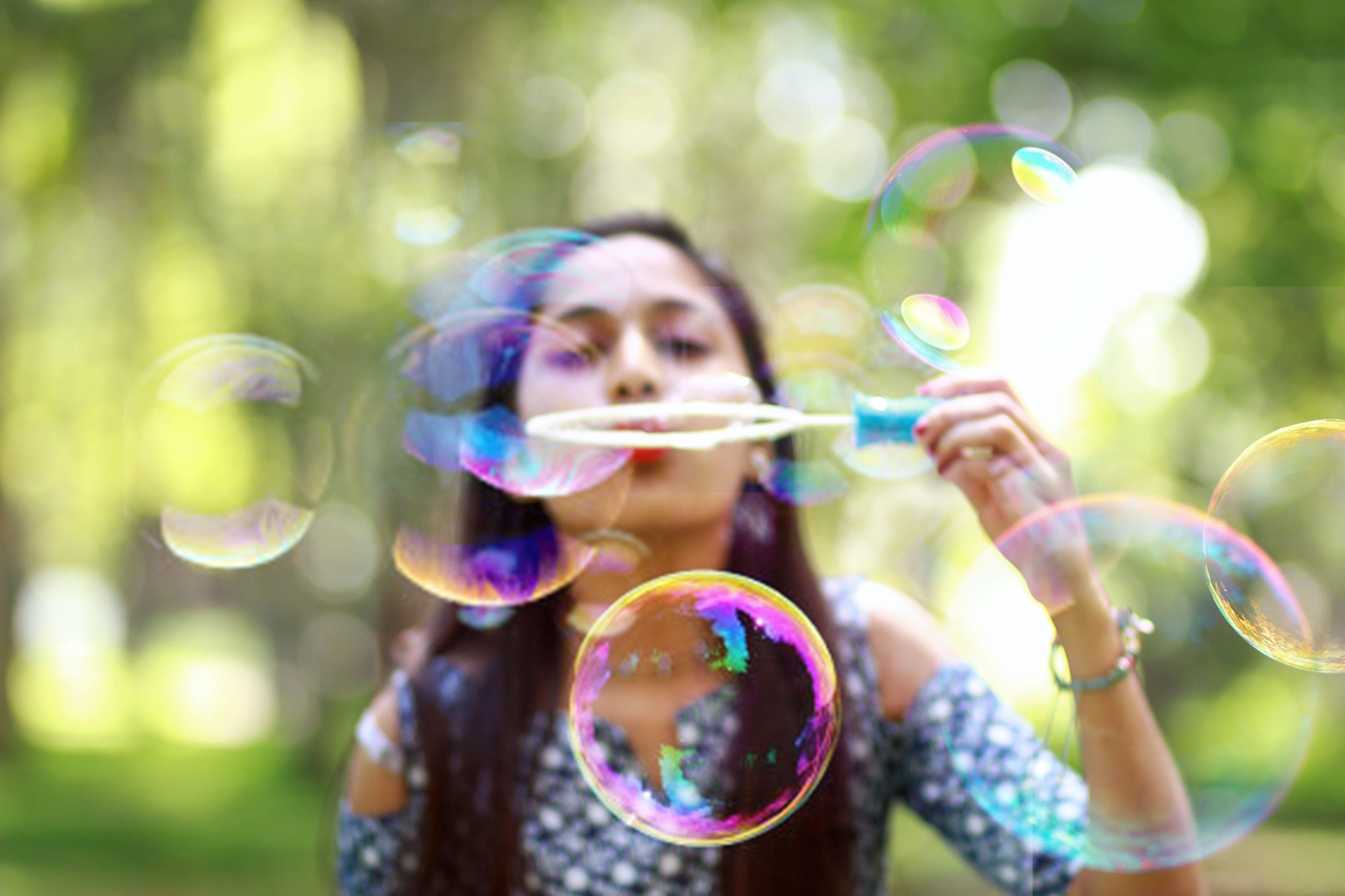 Woman Blowing Bubbles