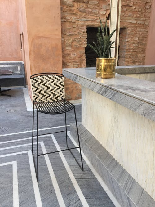 Details of interior of lobby bar with wicker stool