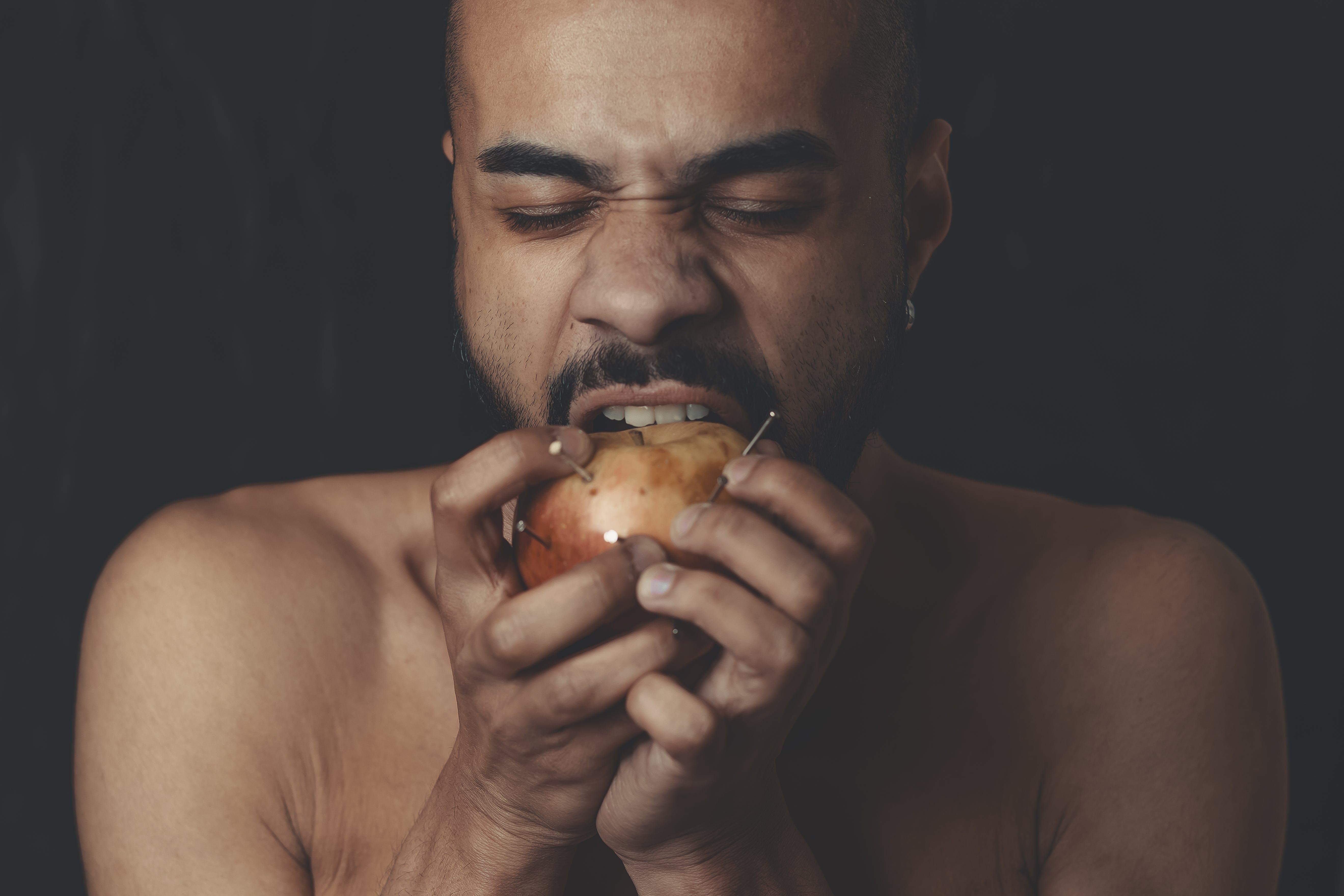 Man Biting Apple Fruit