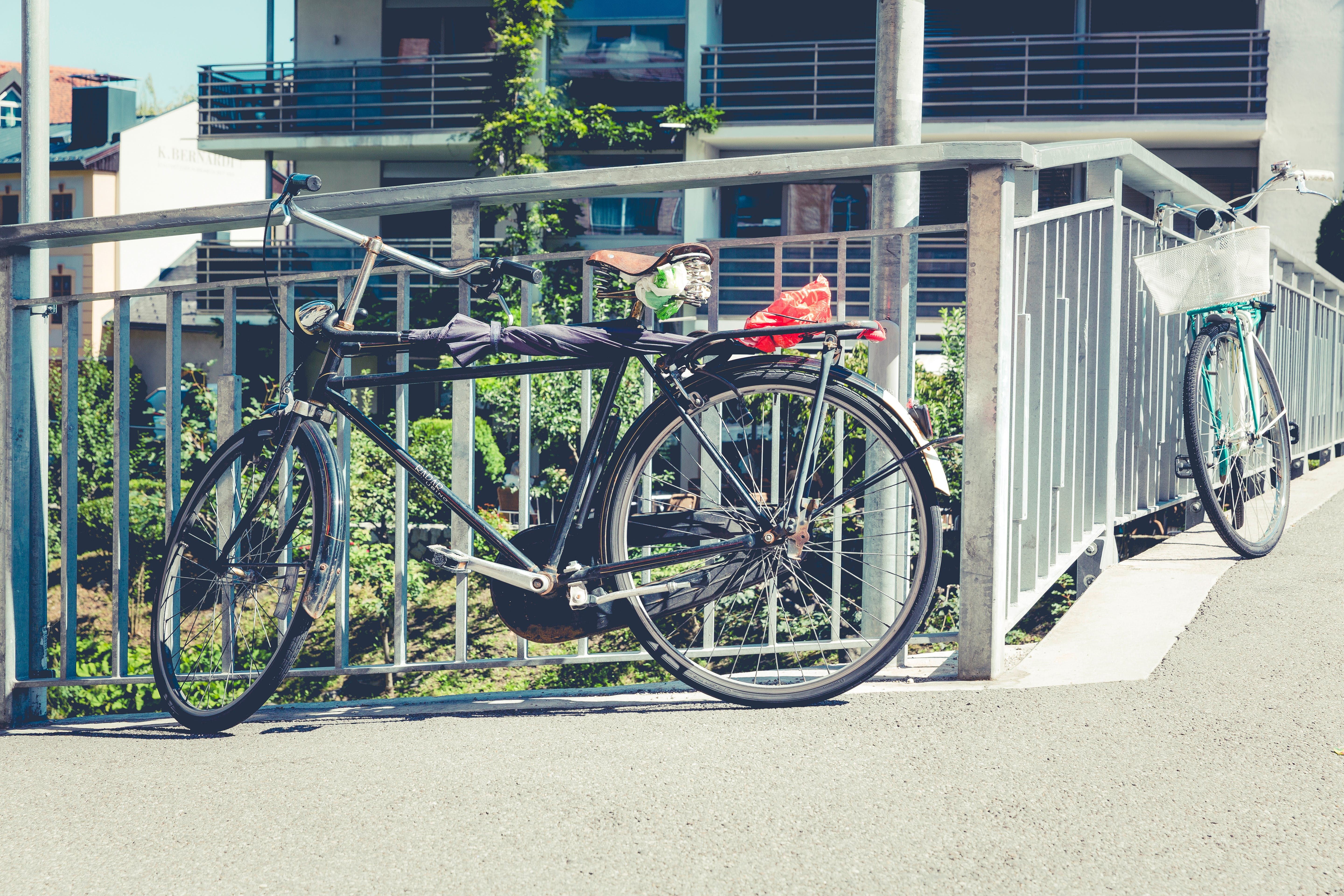 Two Parked Bikes on Gray Metal Rails