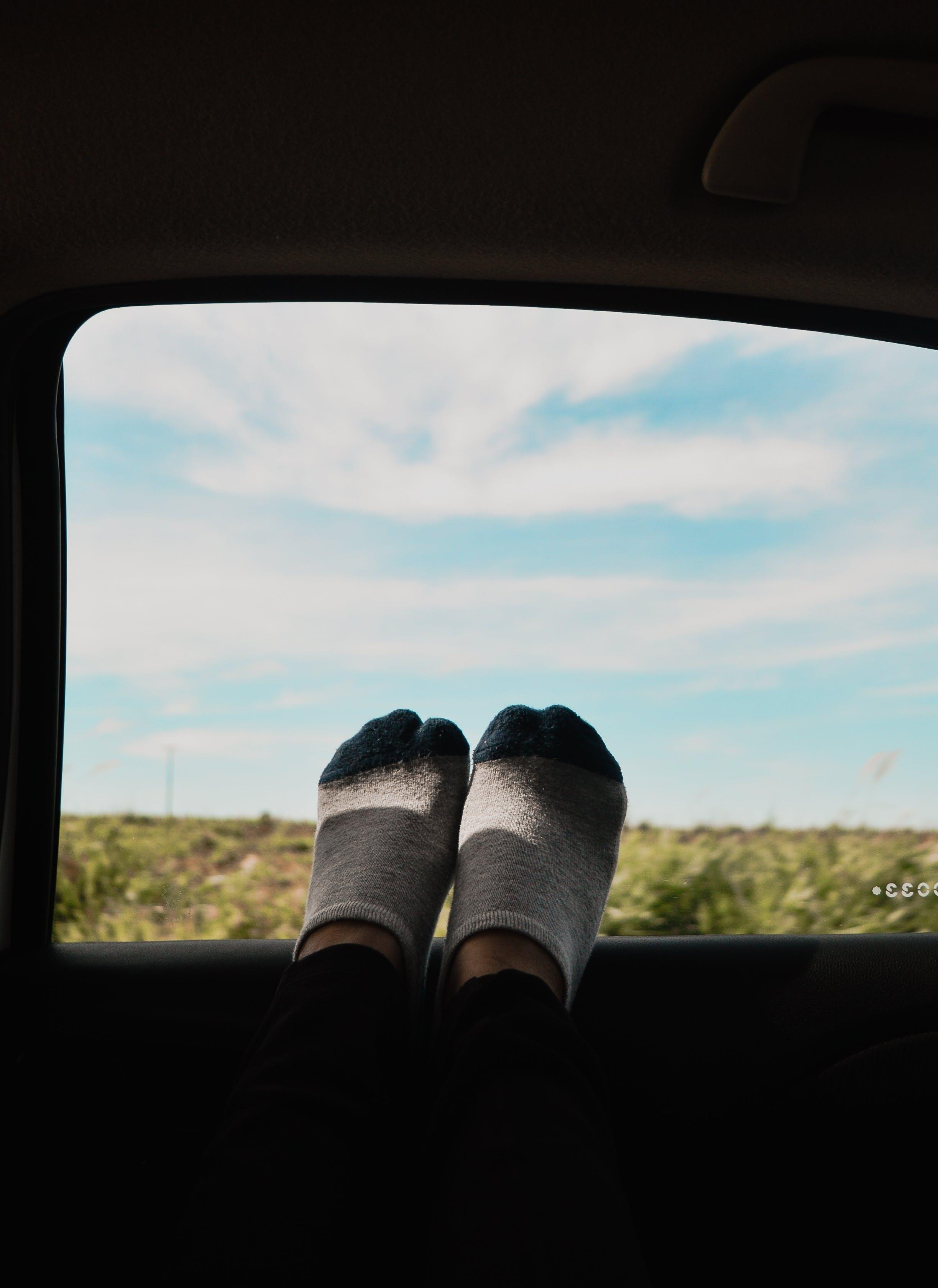 Feet On Car Window