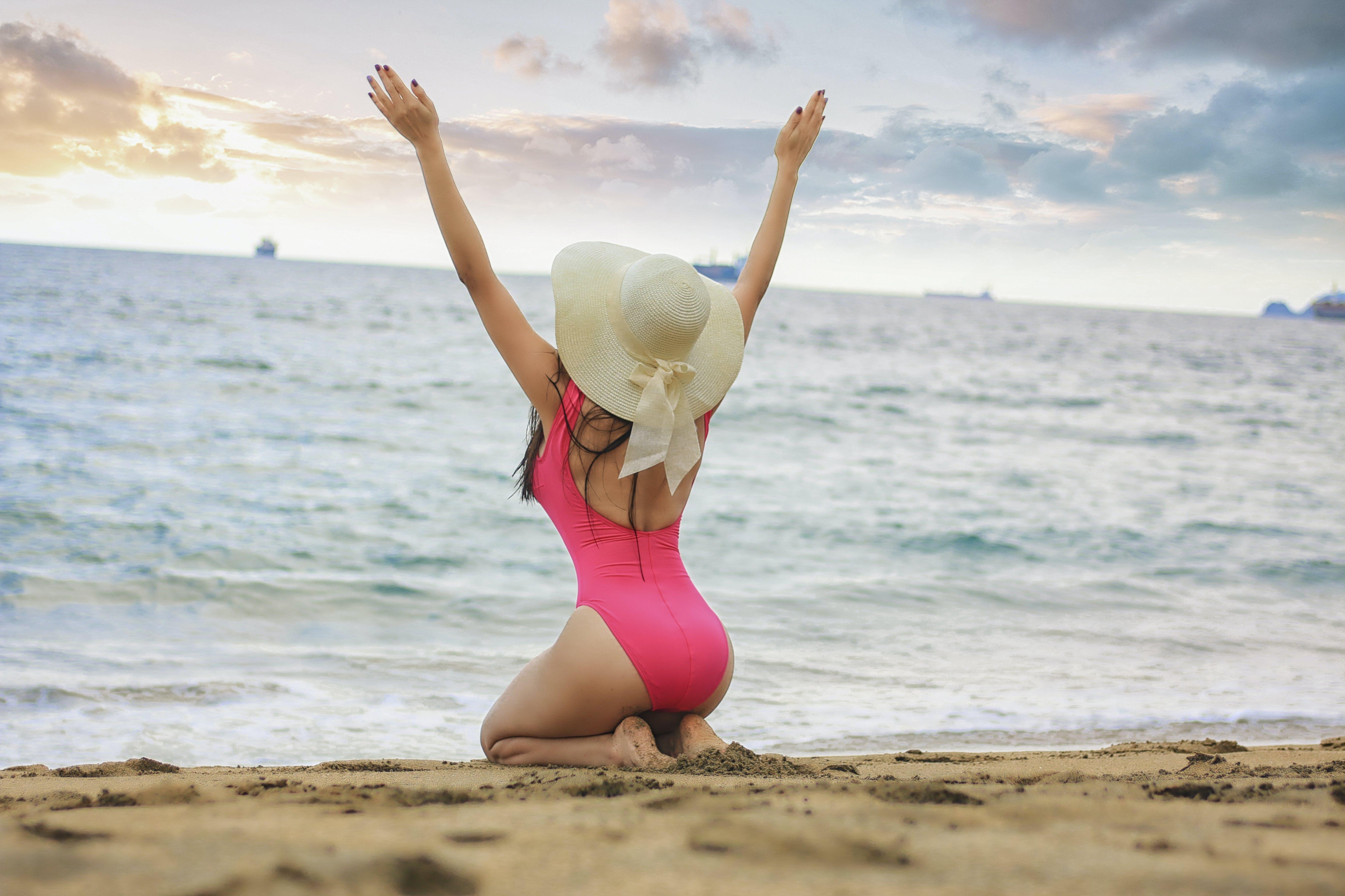 Photo of Woman Kneeling On Seashore