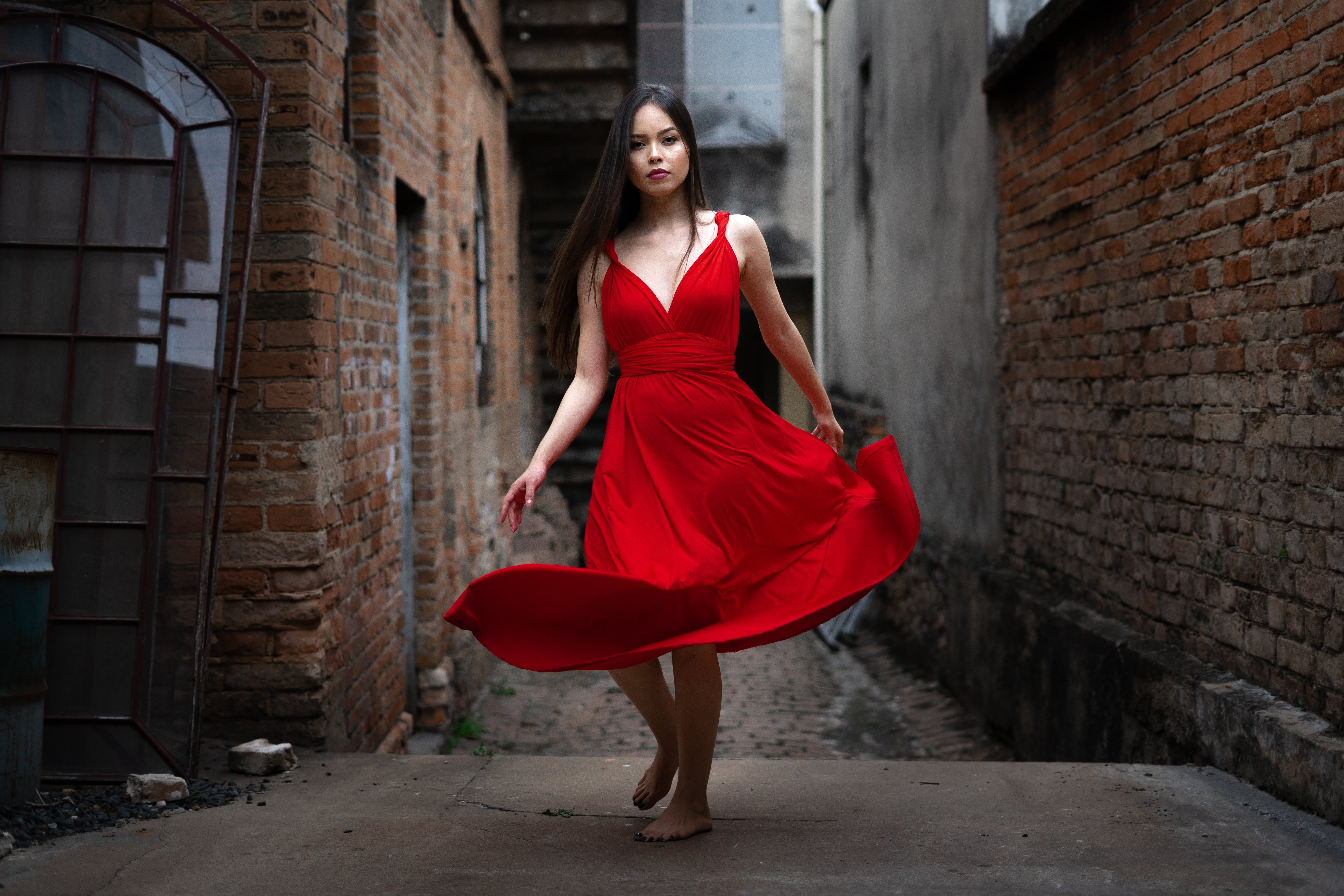 Selective Focus Photography of Woman in Red Dress
