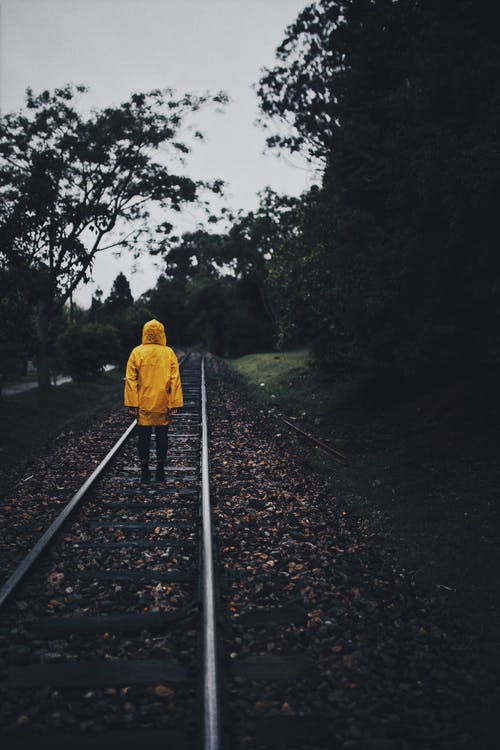 Person Standing on Train Rail