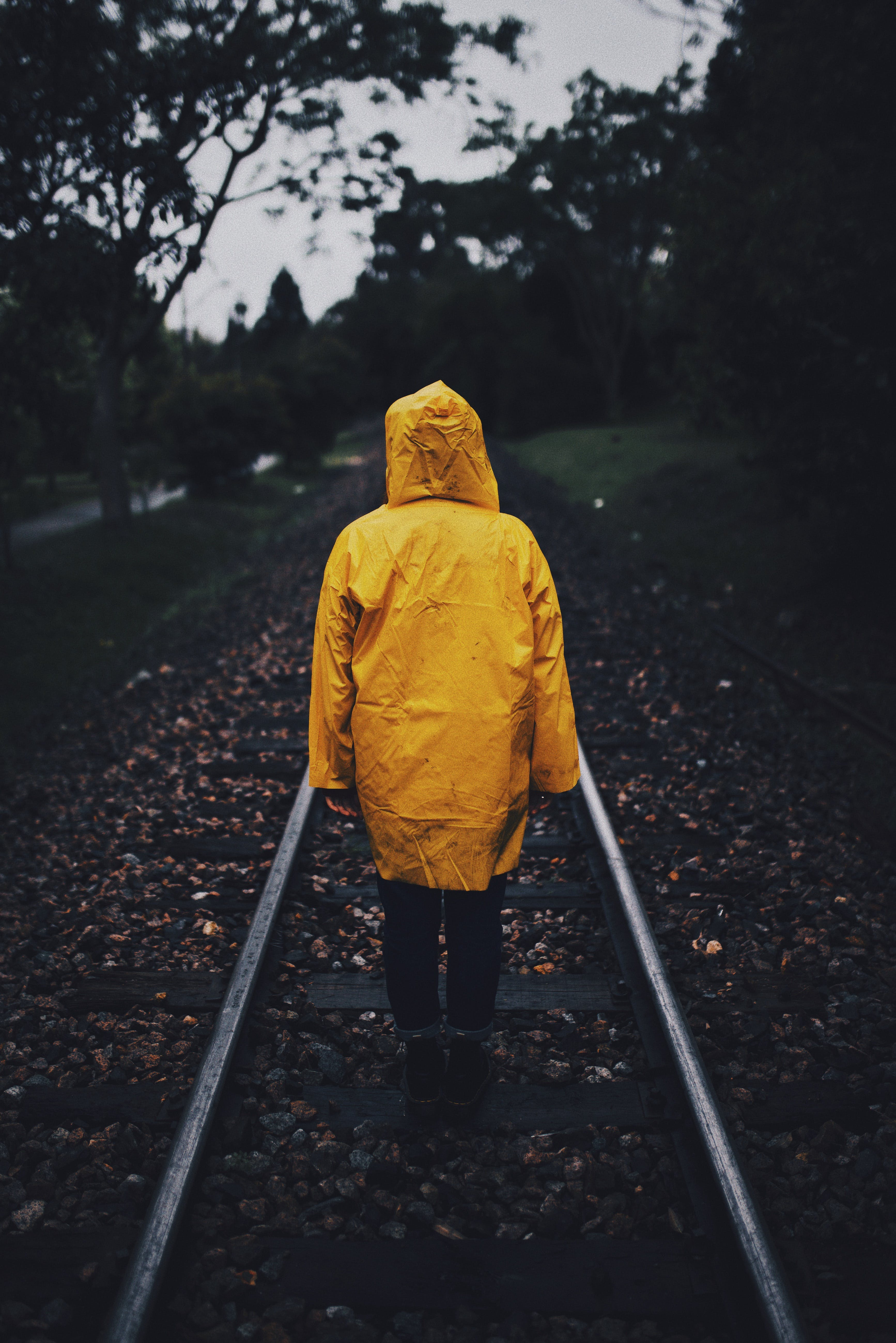 Photo of Person Wearing Raincoat in a Railway