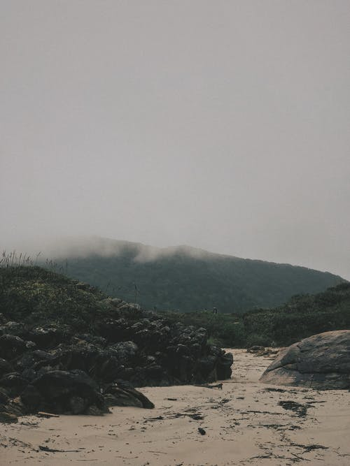 Mountain Under White Clouds