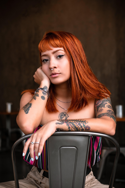 Woman Sitting on Gray Metal Chair