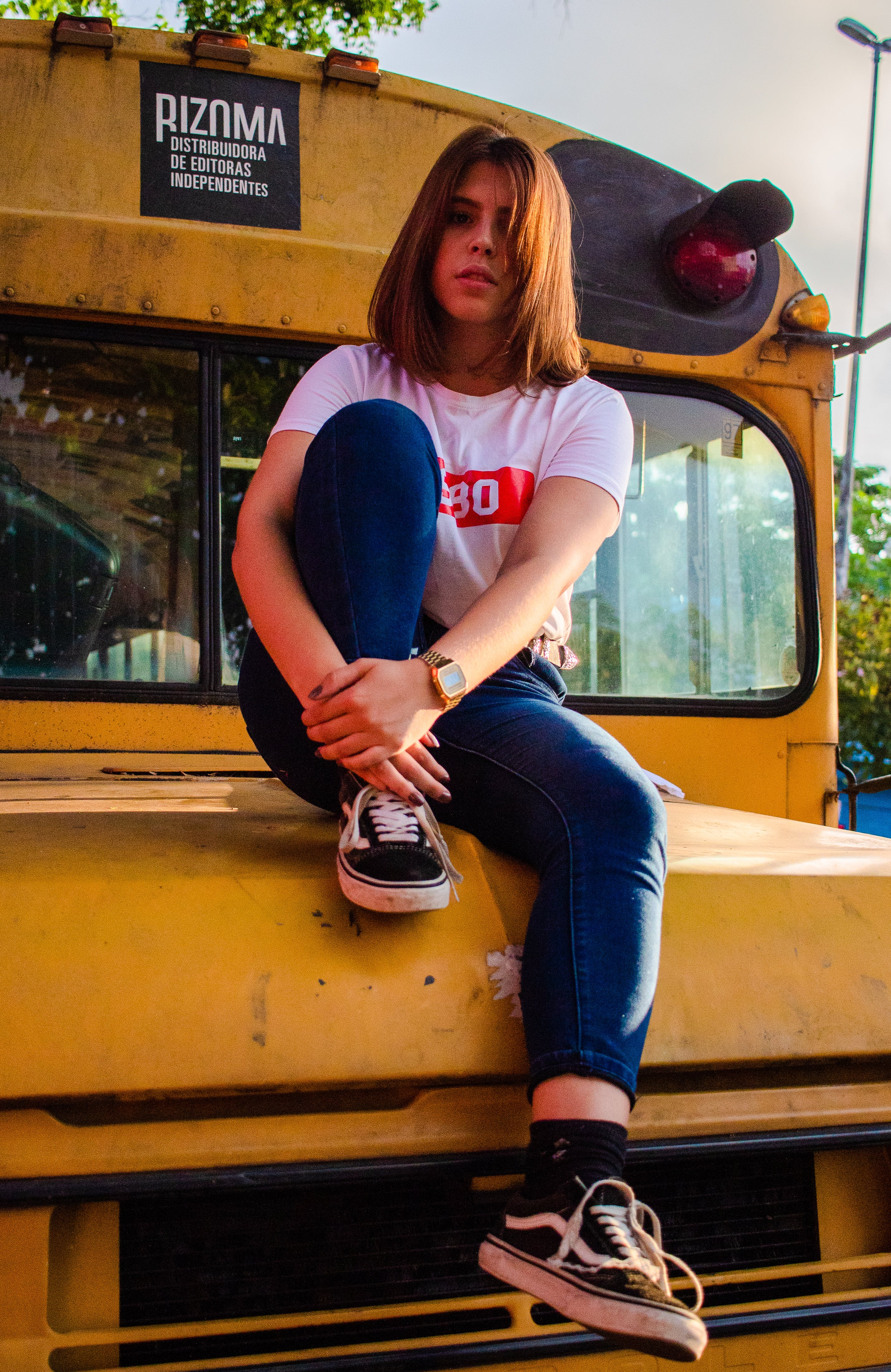 Woman Wearing White T-shirt Sitting on Bus