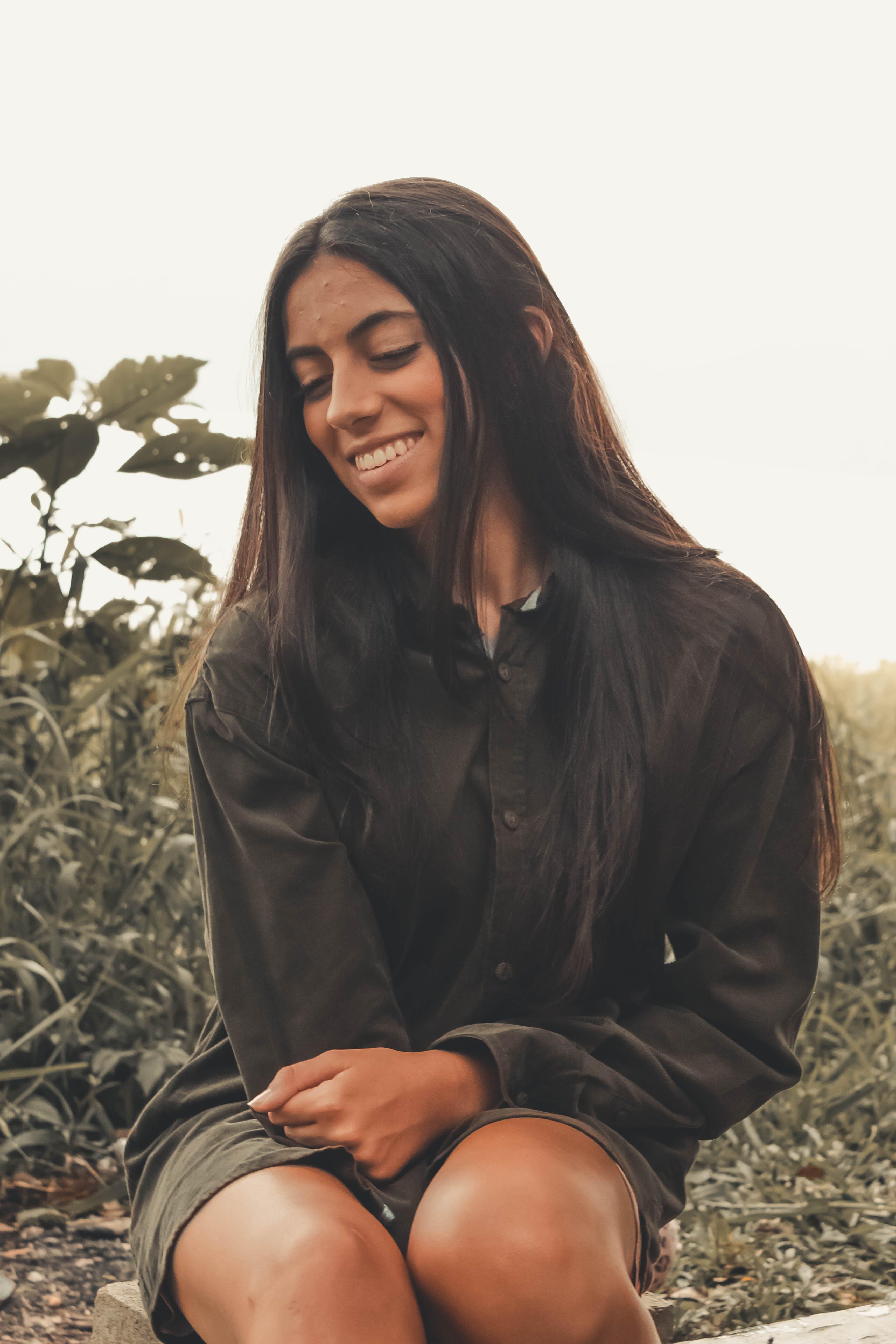 Woman Smiling Near Bushes