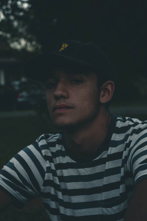 Photo of Man Wearing Striped Shirt