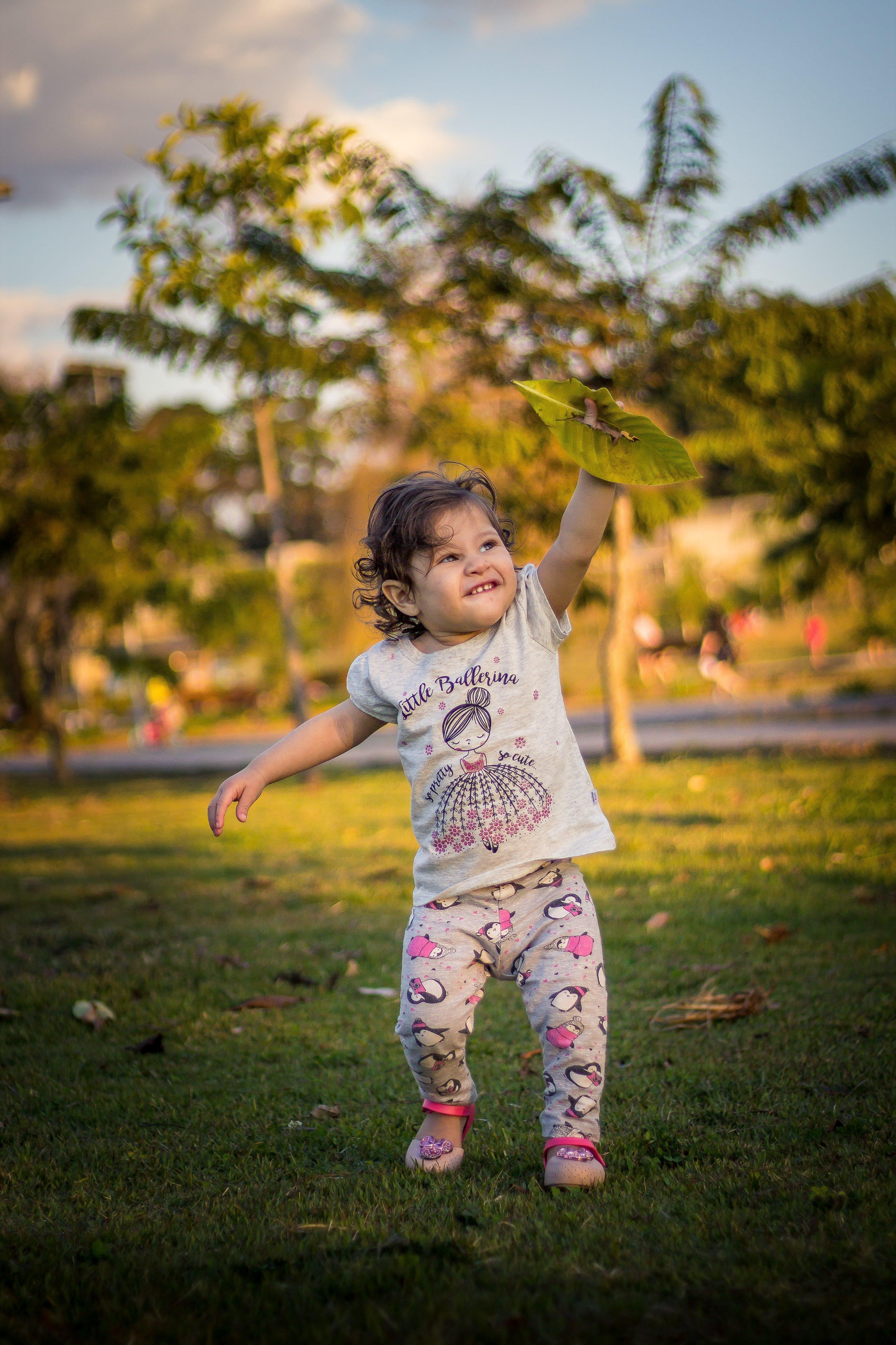 Girl Holding Green Leaf