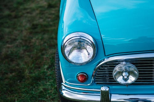 Teal Car With Round Headlight Attached