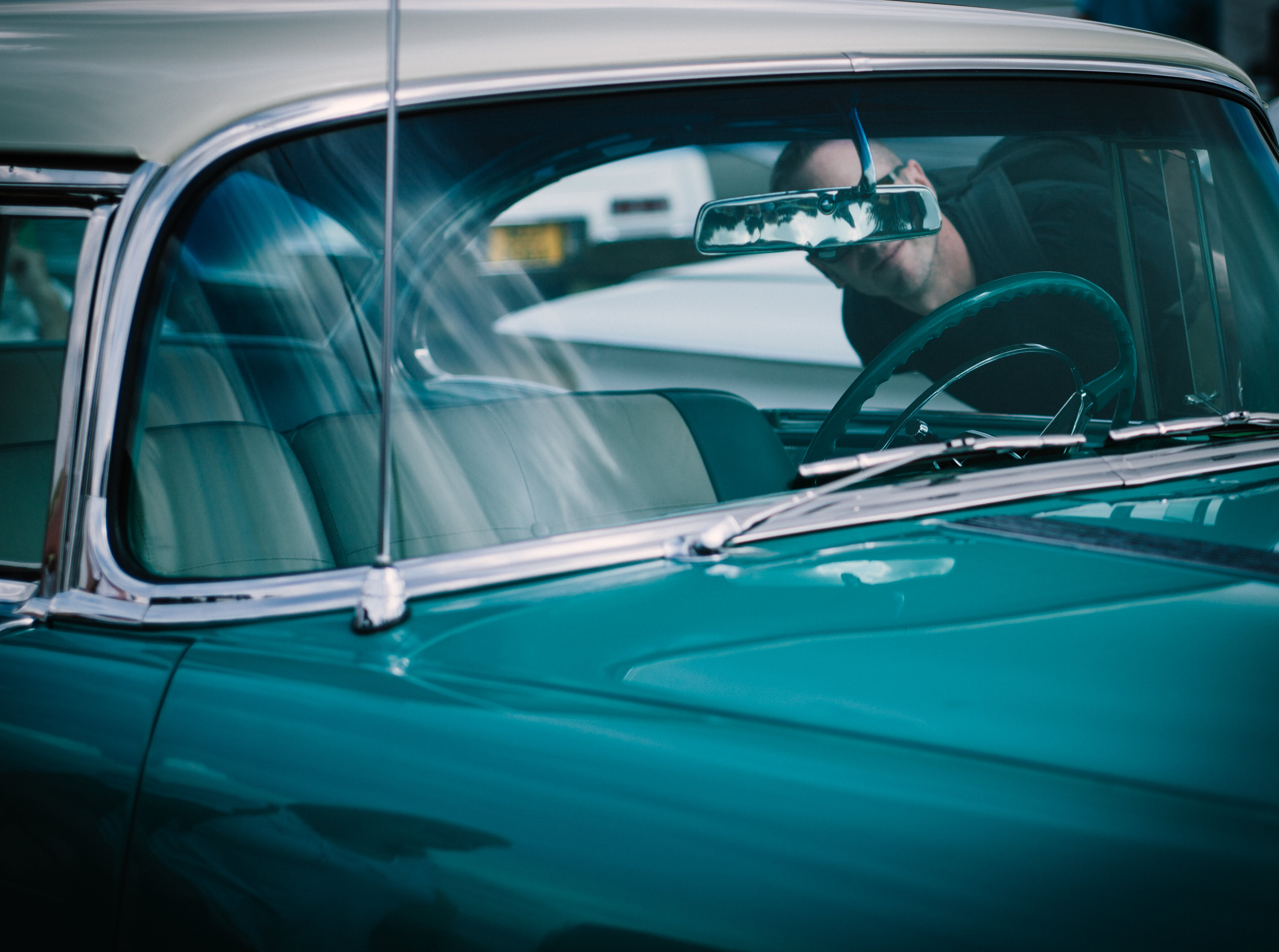 Man Looking at Classic Car