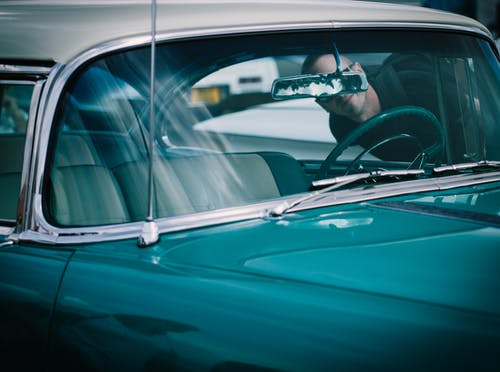 Man Looking at Classic Car