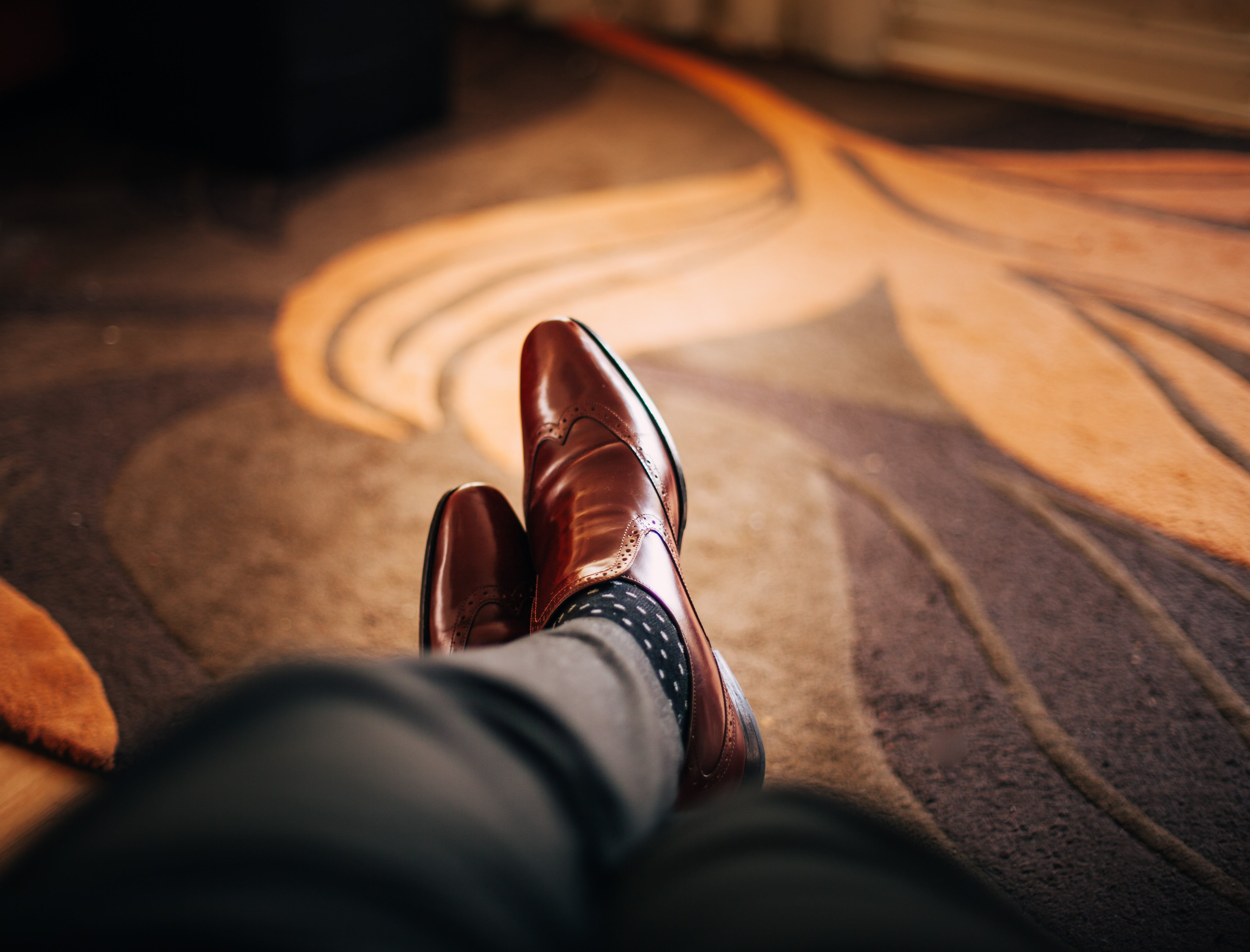 Shallow Focus Photography of Person Wearing Brown Leather Dress Shoes