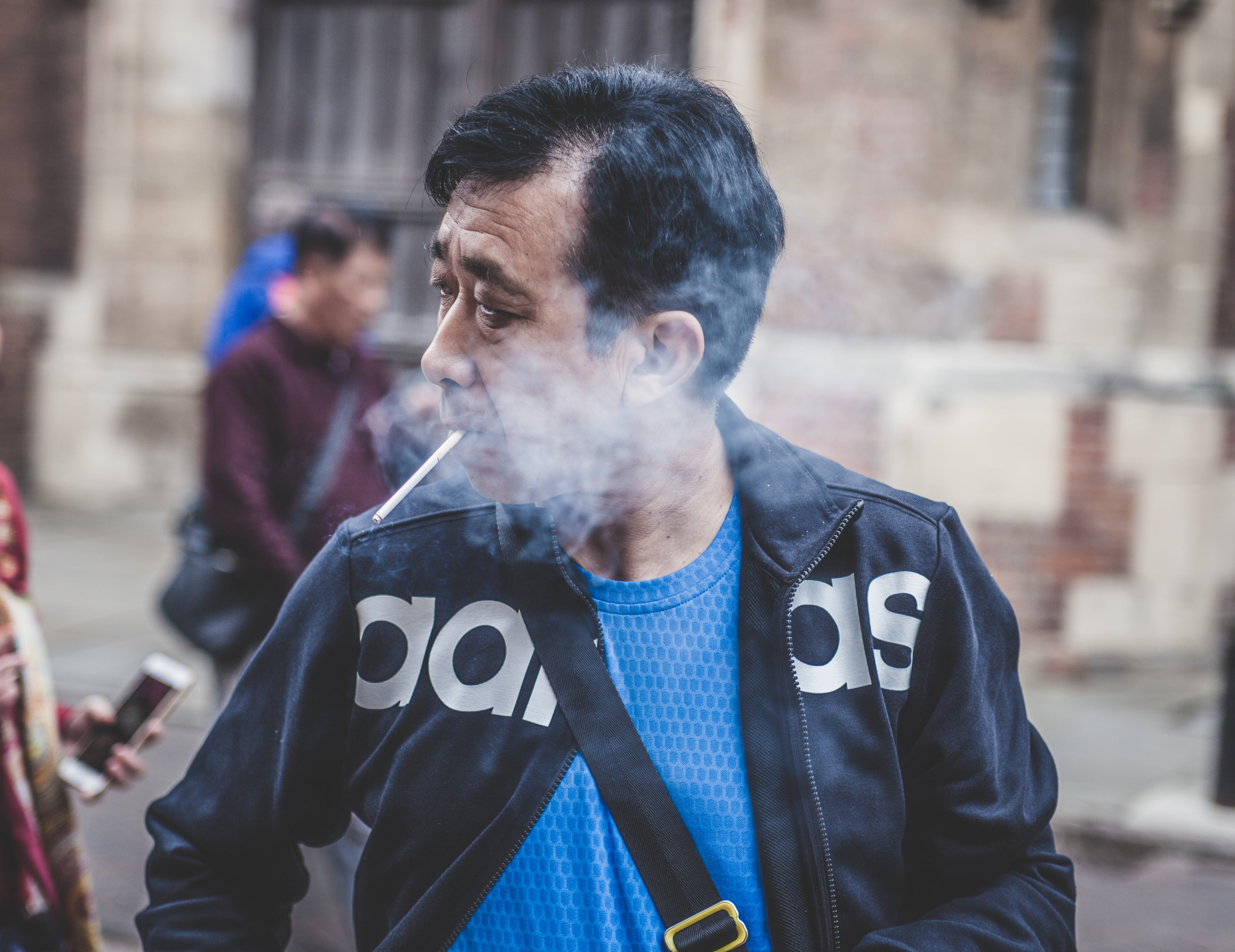Man Smoking While Looking on Right Side