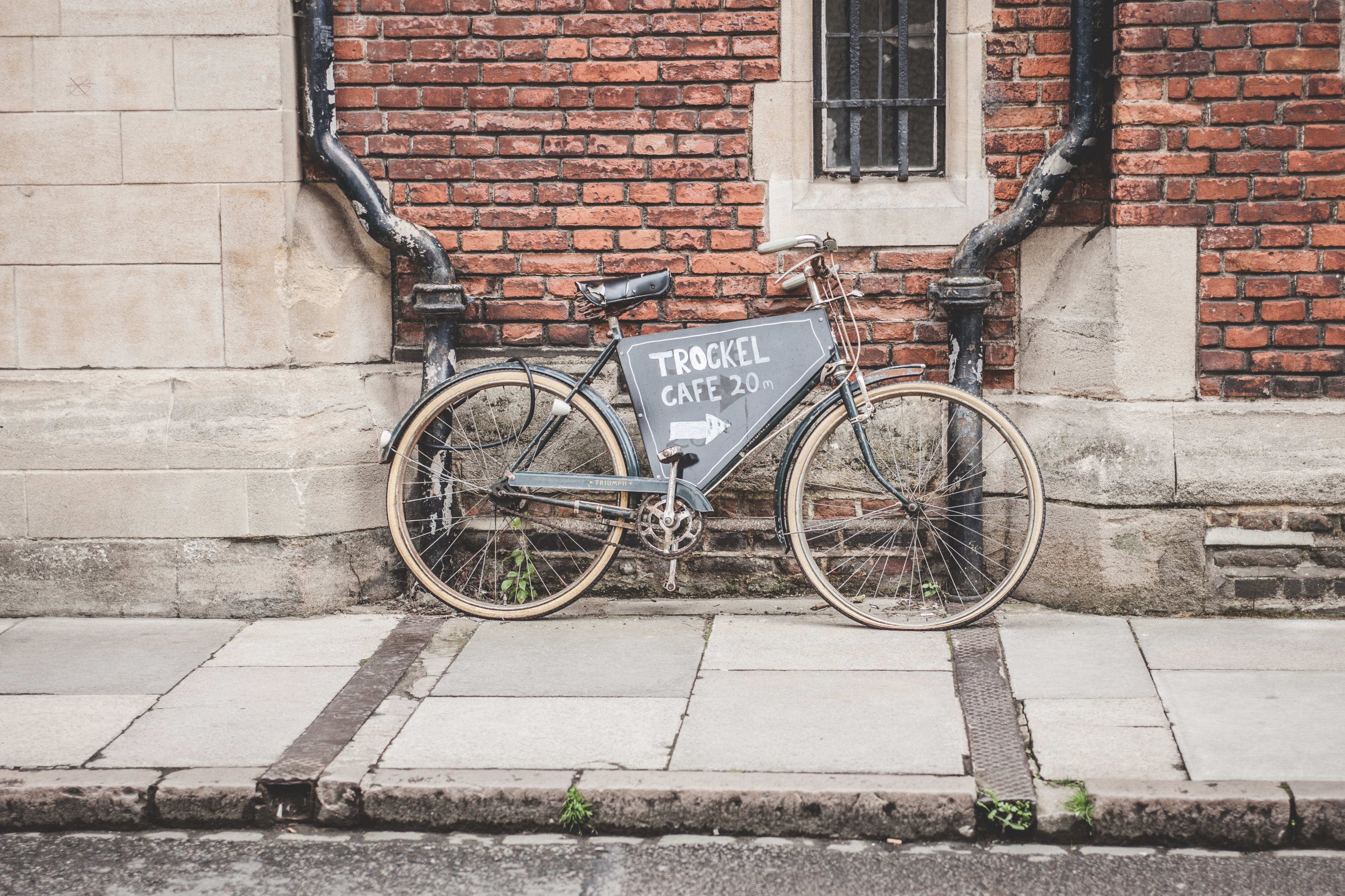 Brown City Bike Leaning on Wall