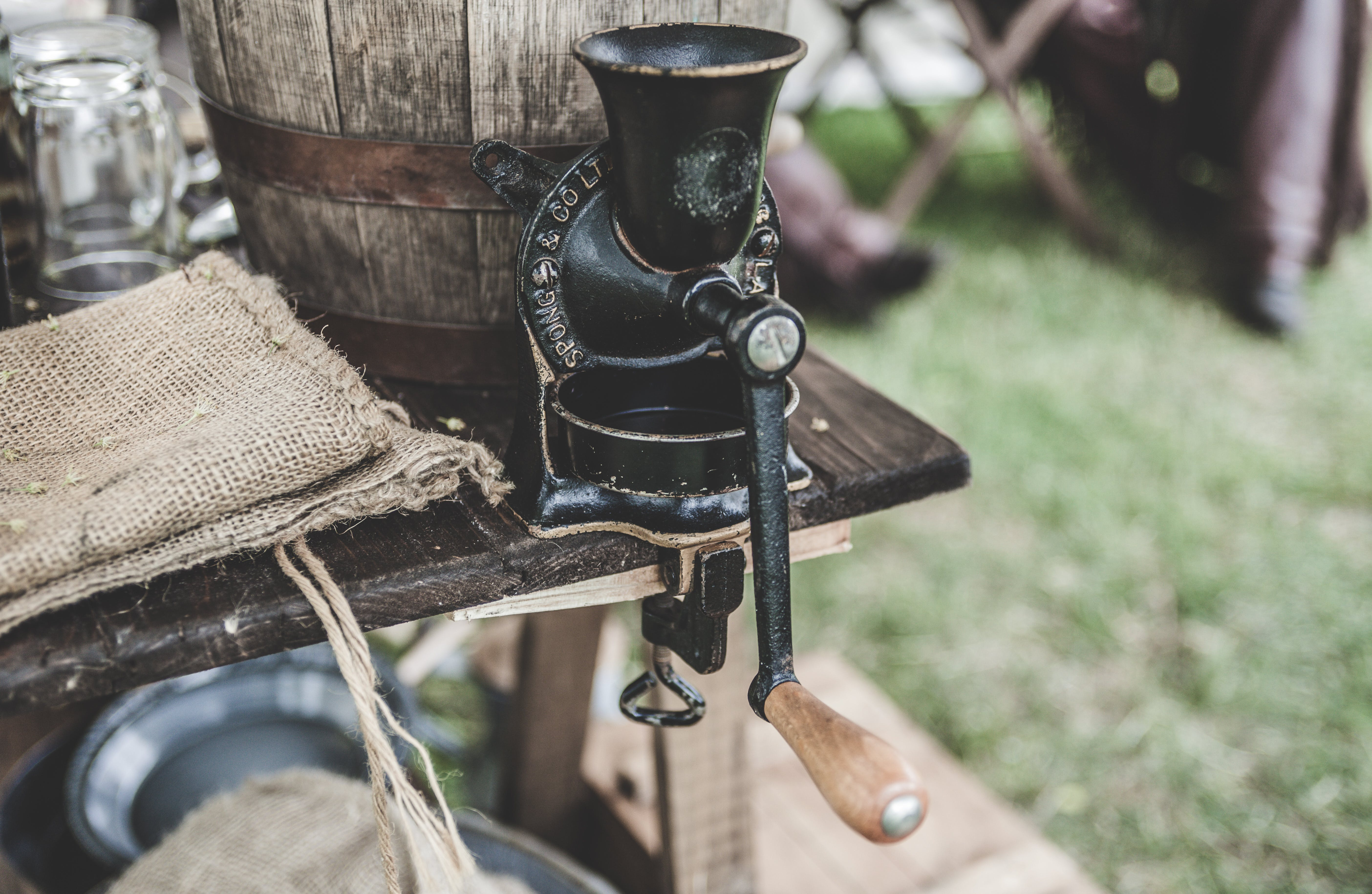 Black Steel Grinder on Brown Wooden Table