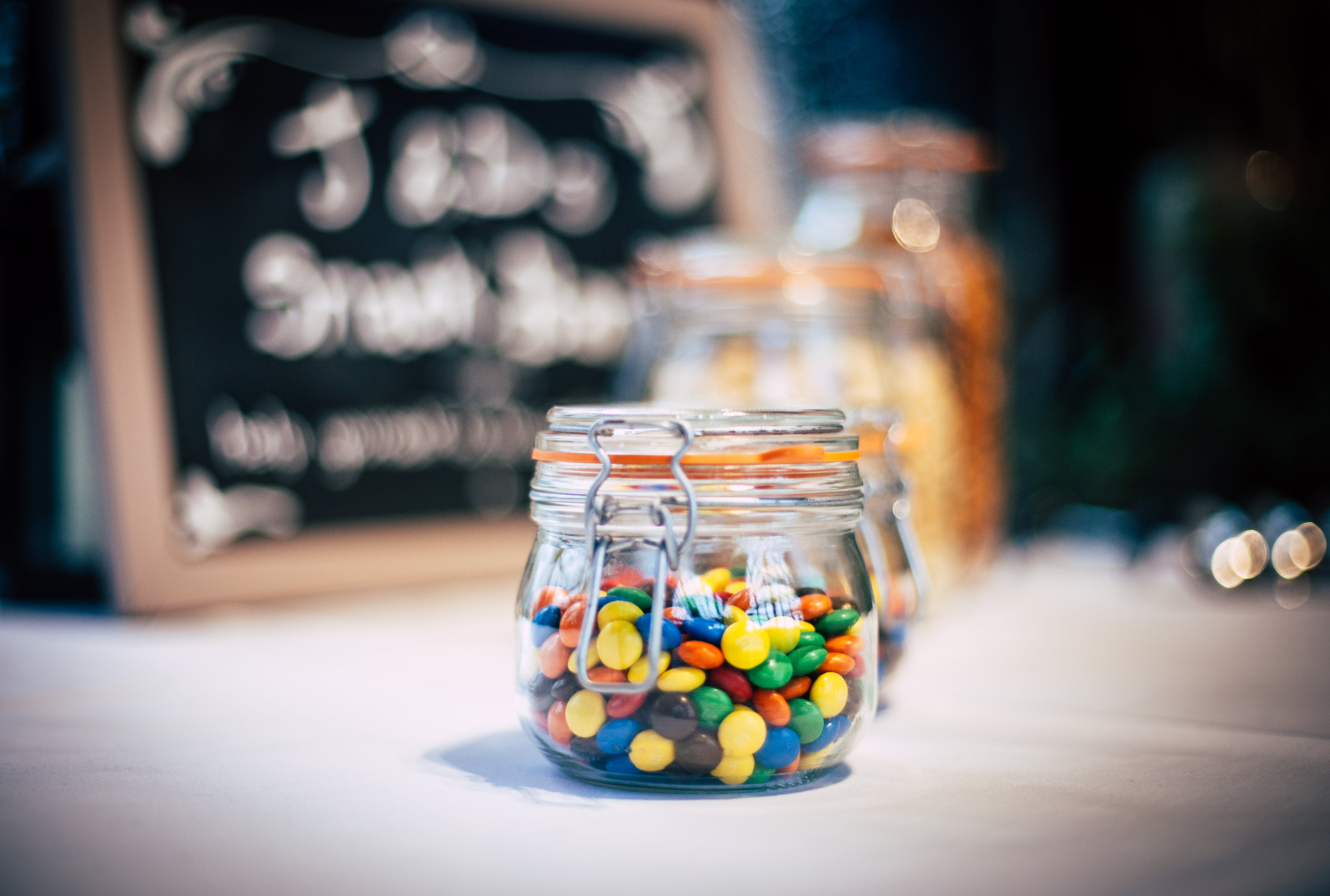 Clamp Lid Jar of Candies on White Surface