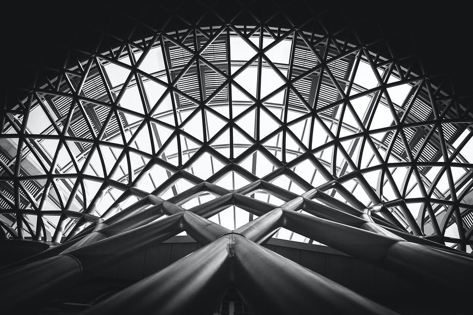 Low Angle Photography Of Building Free Stock Photo: Low Angle Photography Of Metal Building On Grayscale