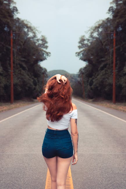 Woman standing on road