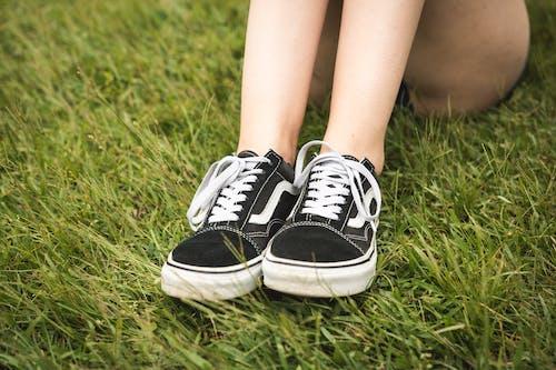 Person Wearing Black Vans Old Skool Skate Shoes