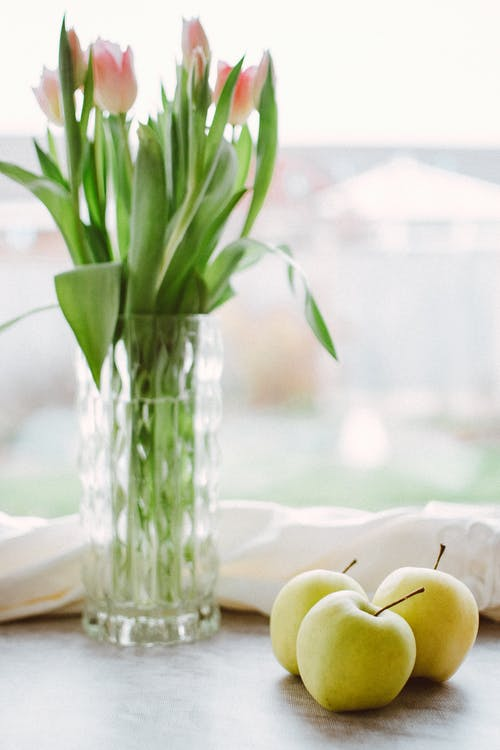 Photo of Apples Near Glass Vase