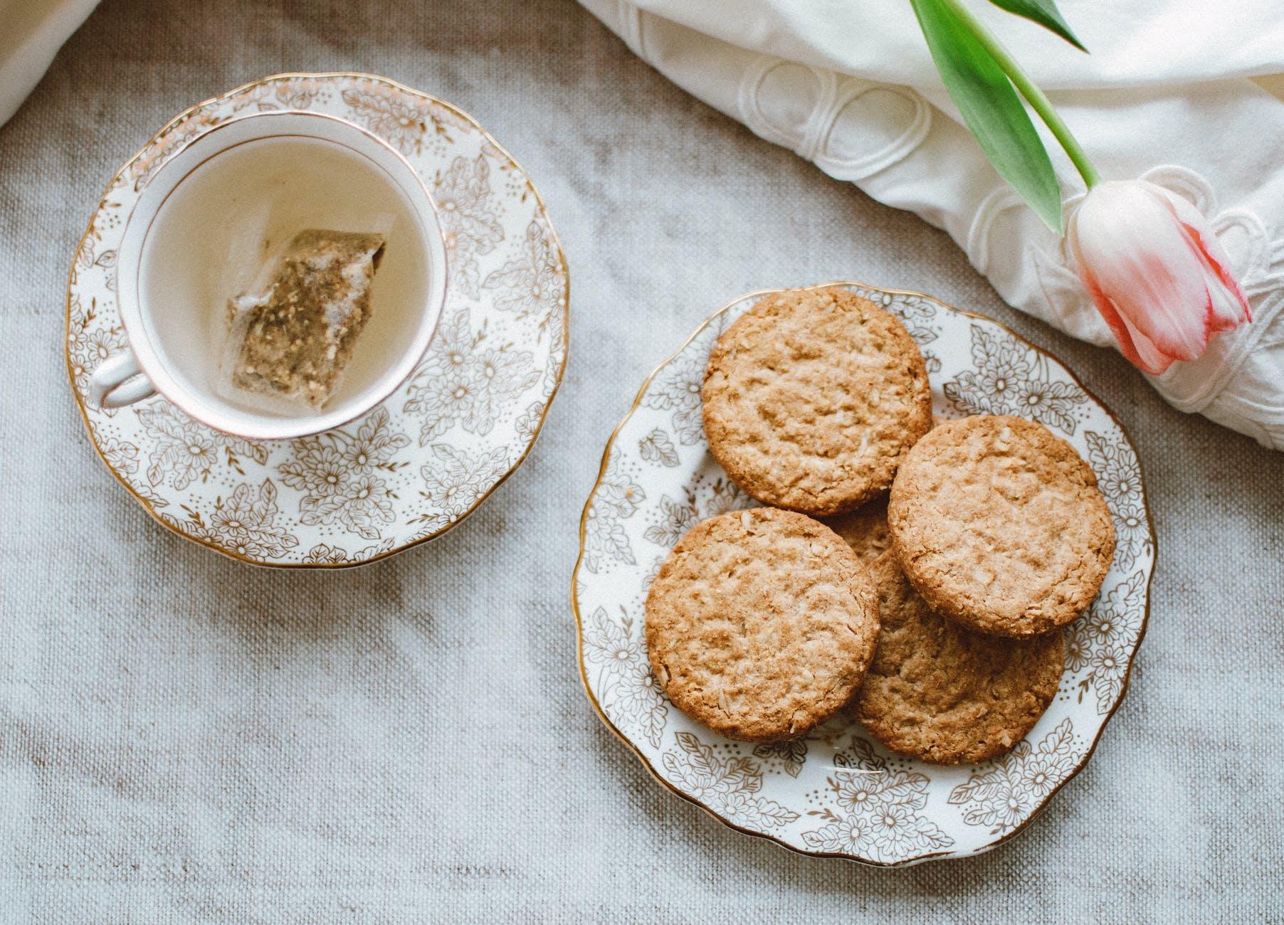 round cookies on bowl beside teacup