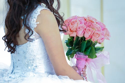 Woman Holding Pink Rose Bouquet
