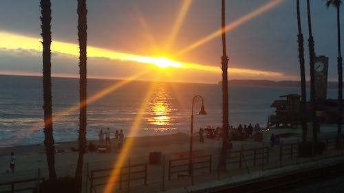 Photos gratuites de coucher de soleil à san clemente, coucher de soleil sur la plage, le soleil couchant sur la plage
