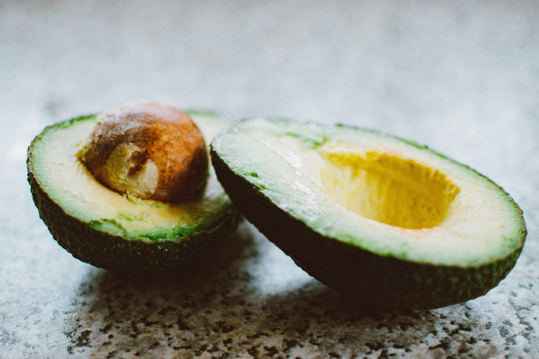 Selective Focus Photography Of Sliced Avocado