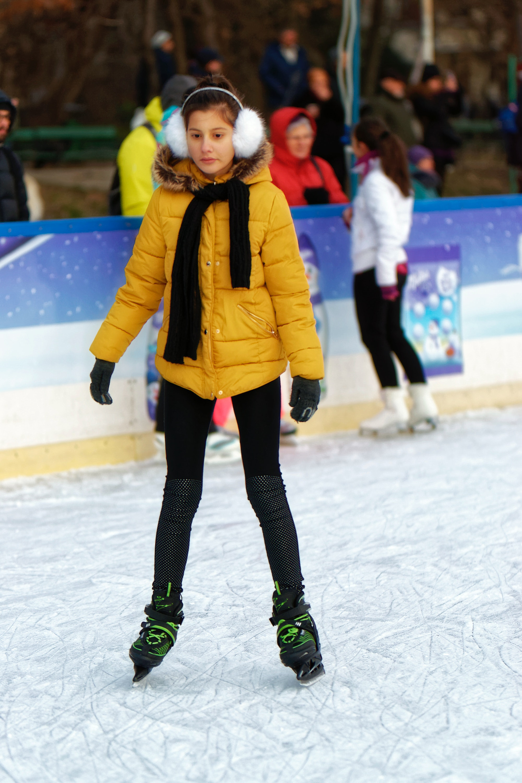 Free stock photo of children, ice skating rink, little girl skating on ice skating rink