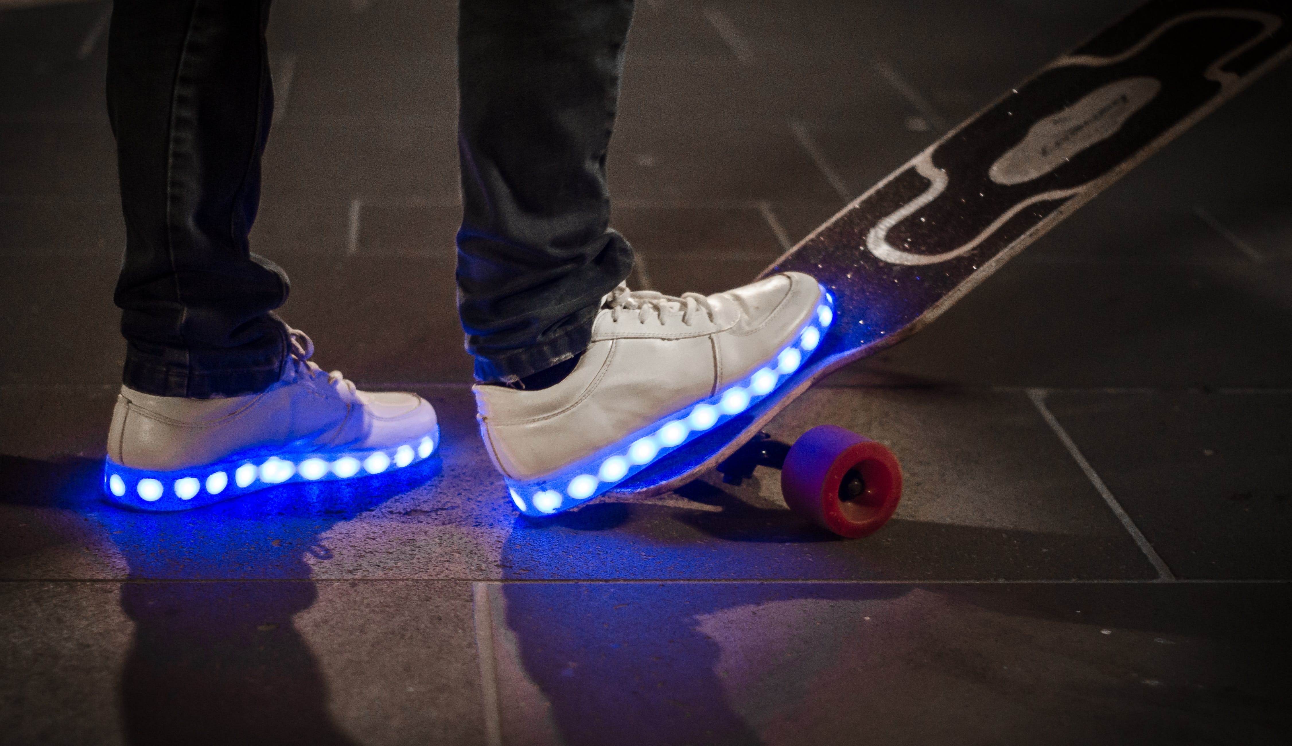 White Sneaker With Led Light on Black and White Long Board