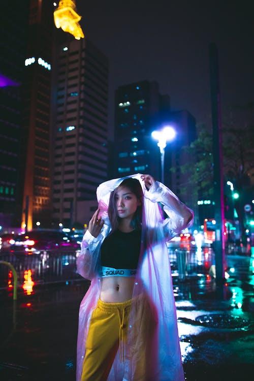 Woman Wearing Pink Rain Coat