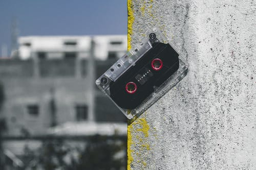 Clear and Black Cassette Tape on Gray Surface