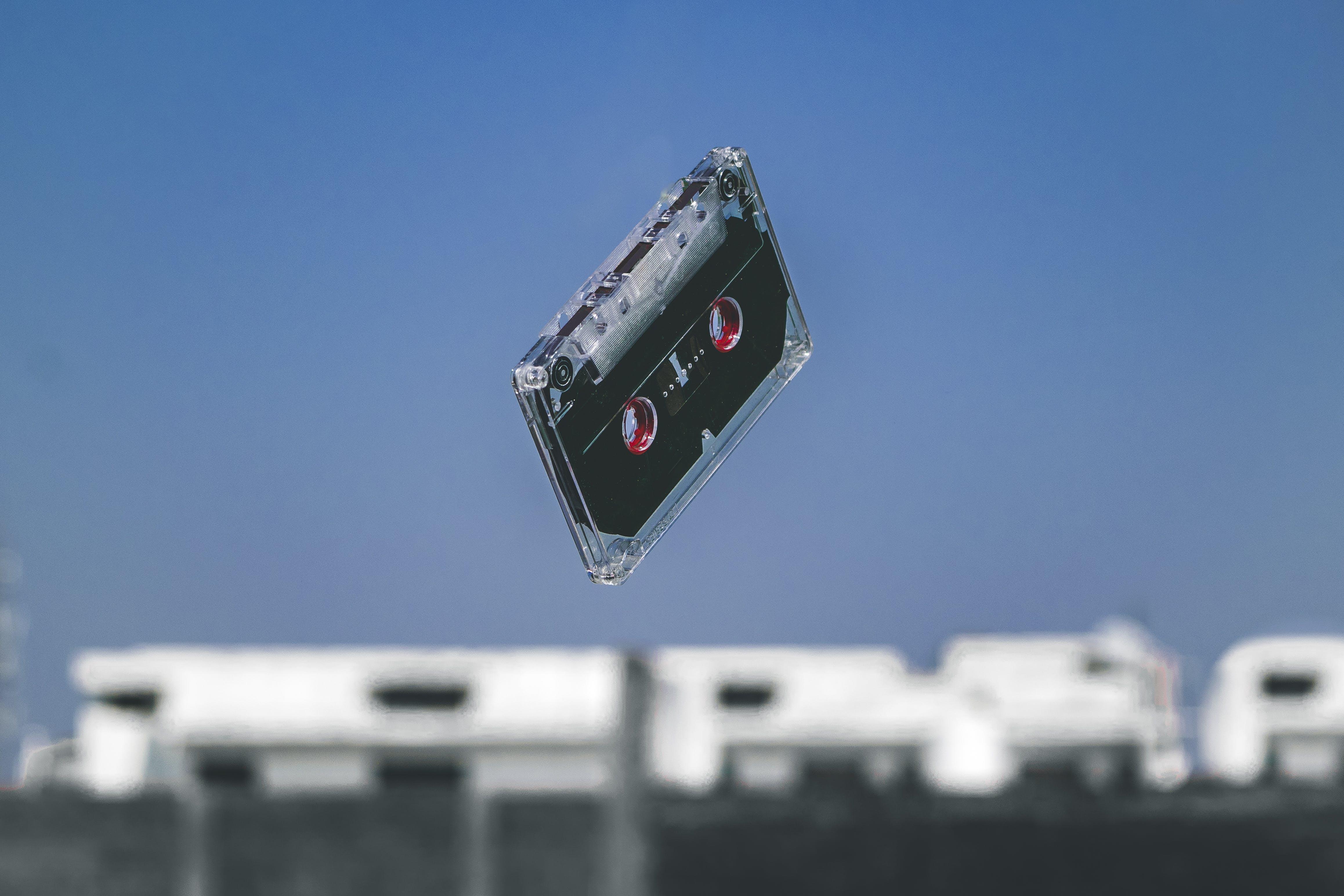 Black Cassette Tape in Mid-air