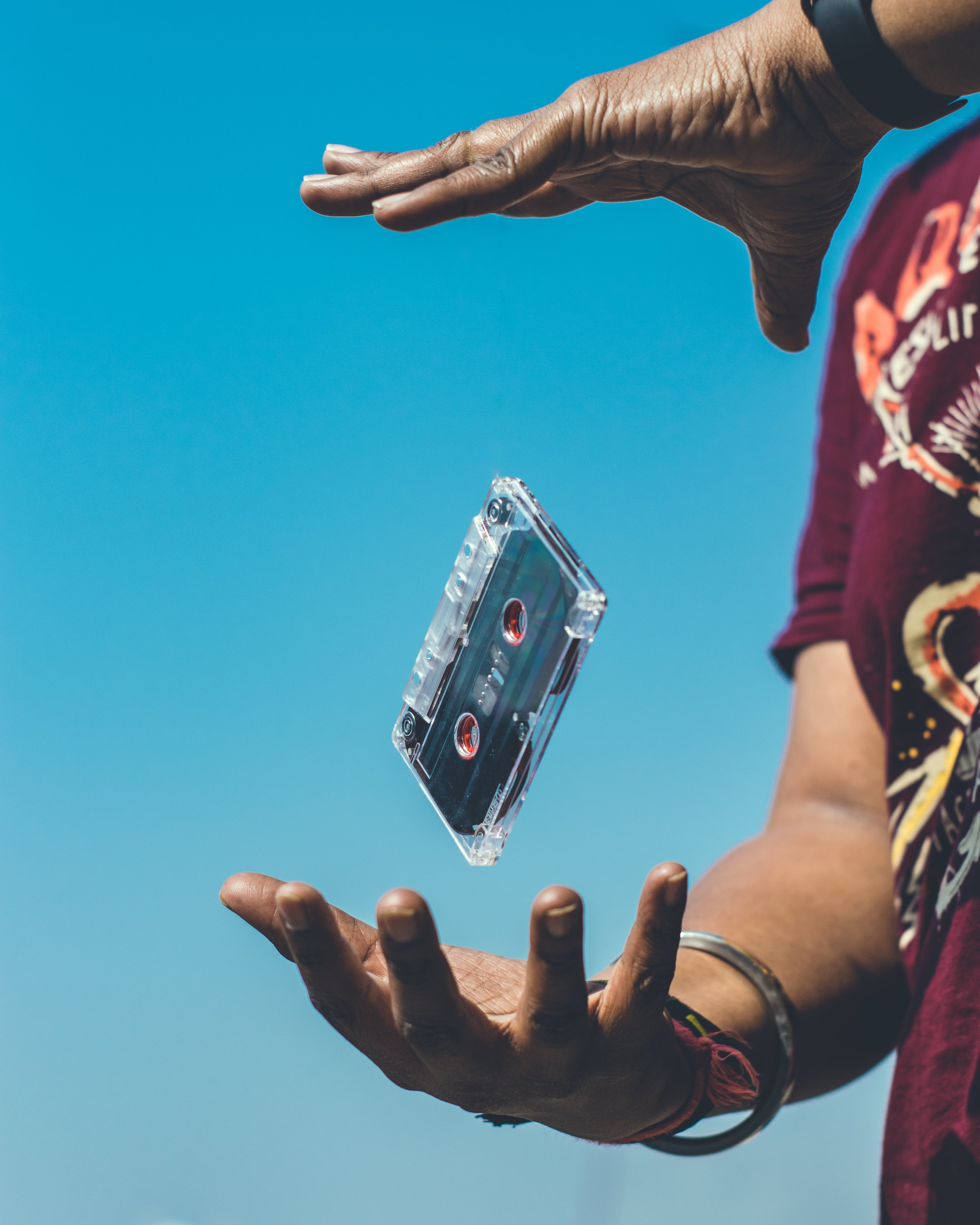 Cassette Tape in Between of Person Hand