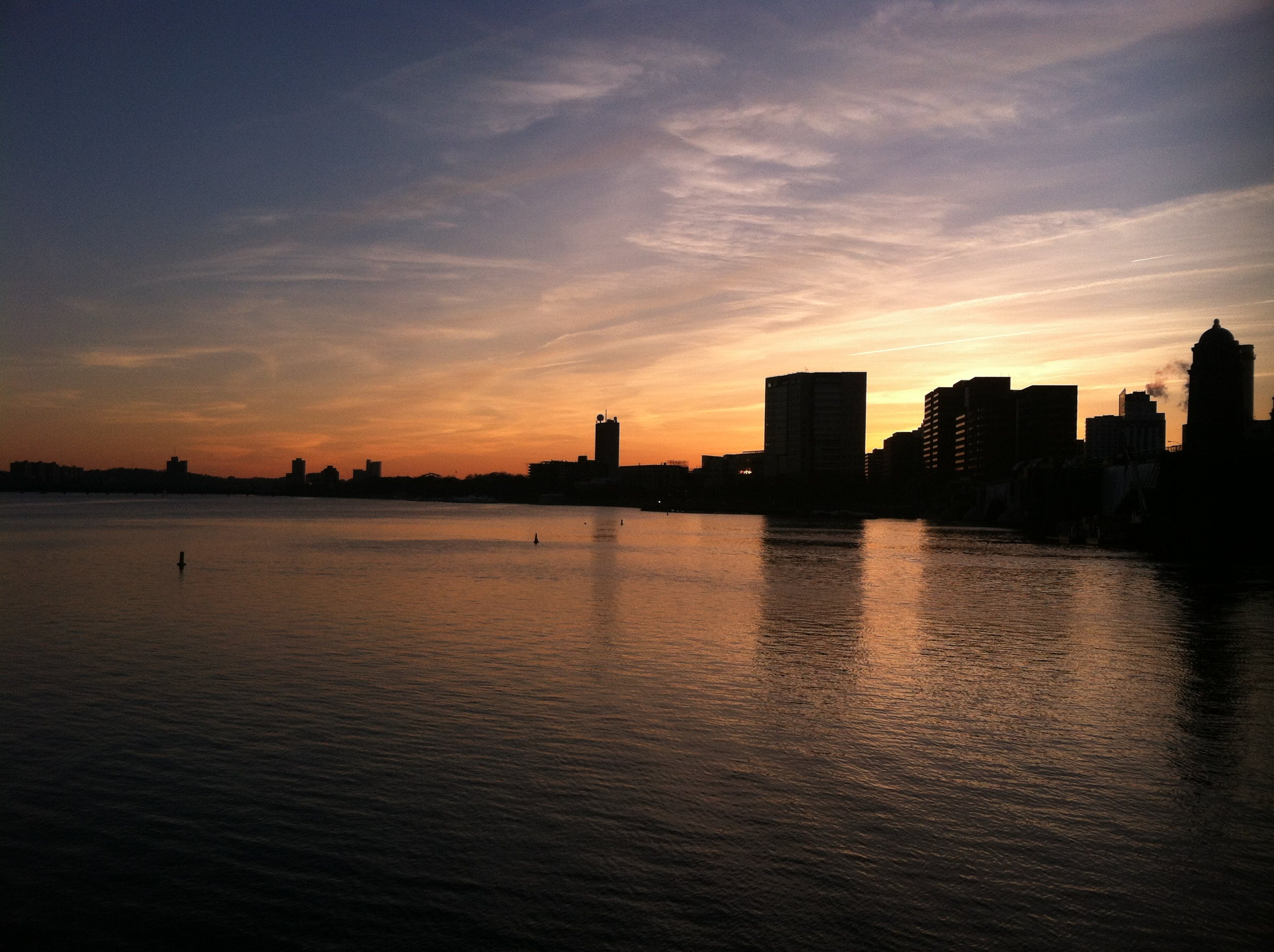Silhouette Photograph of Buildings Near Calm Body of Water