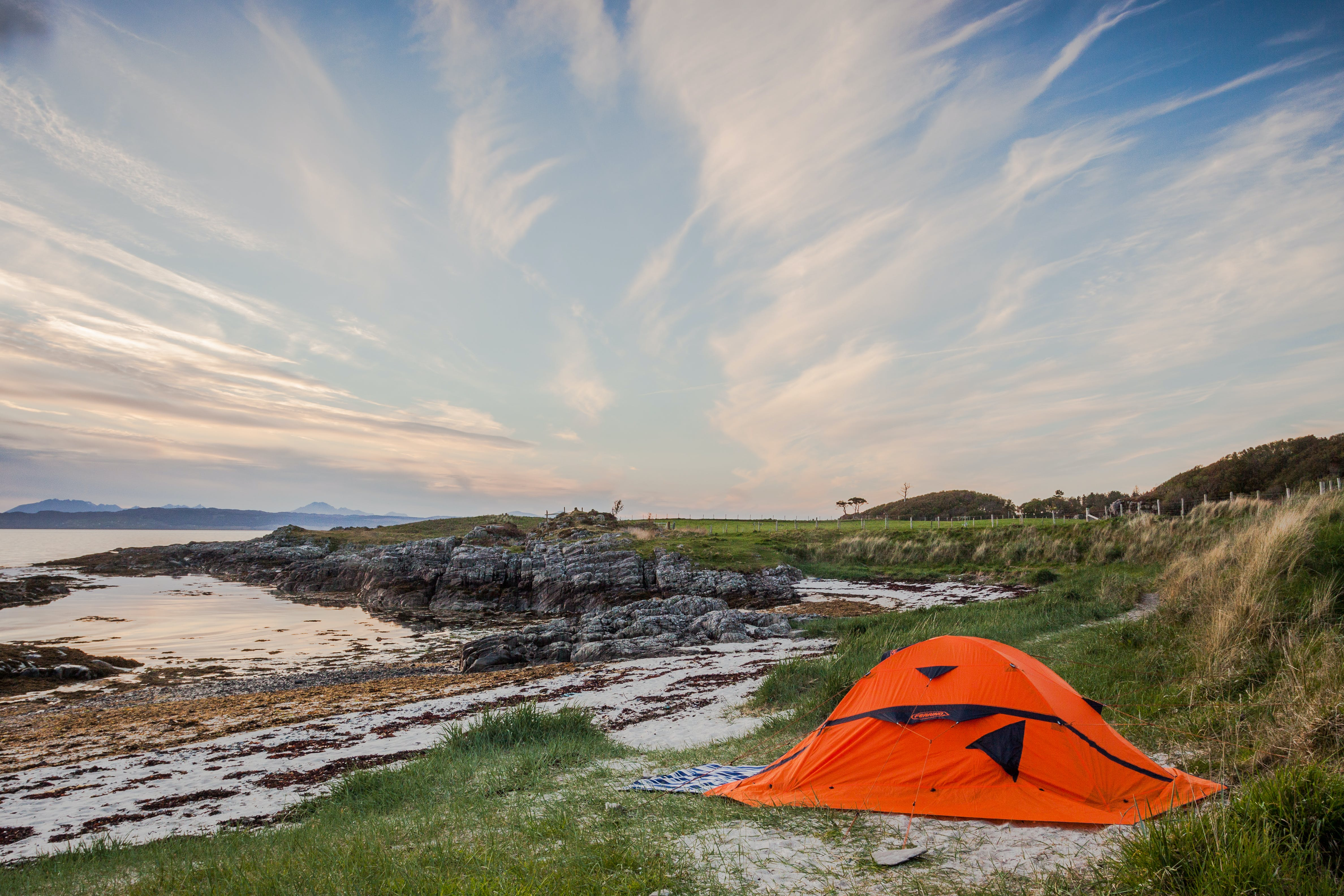 Orange Camping Tent Near Body of Water during Daytime