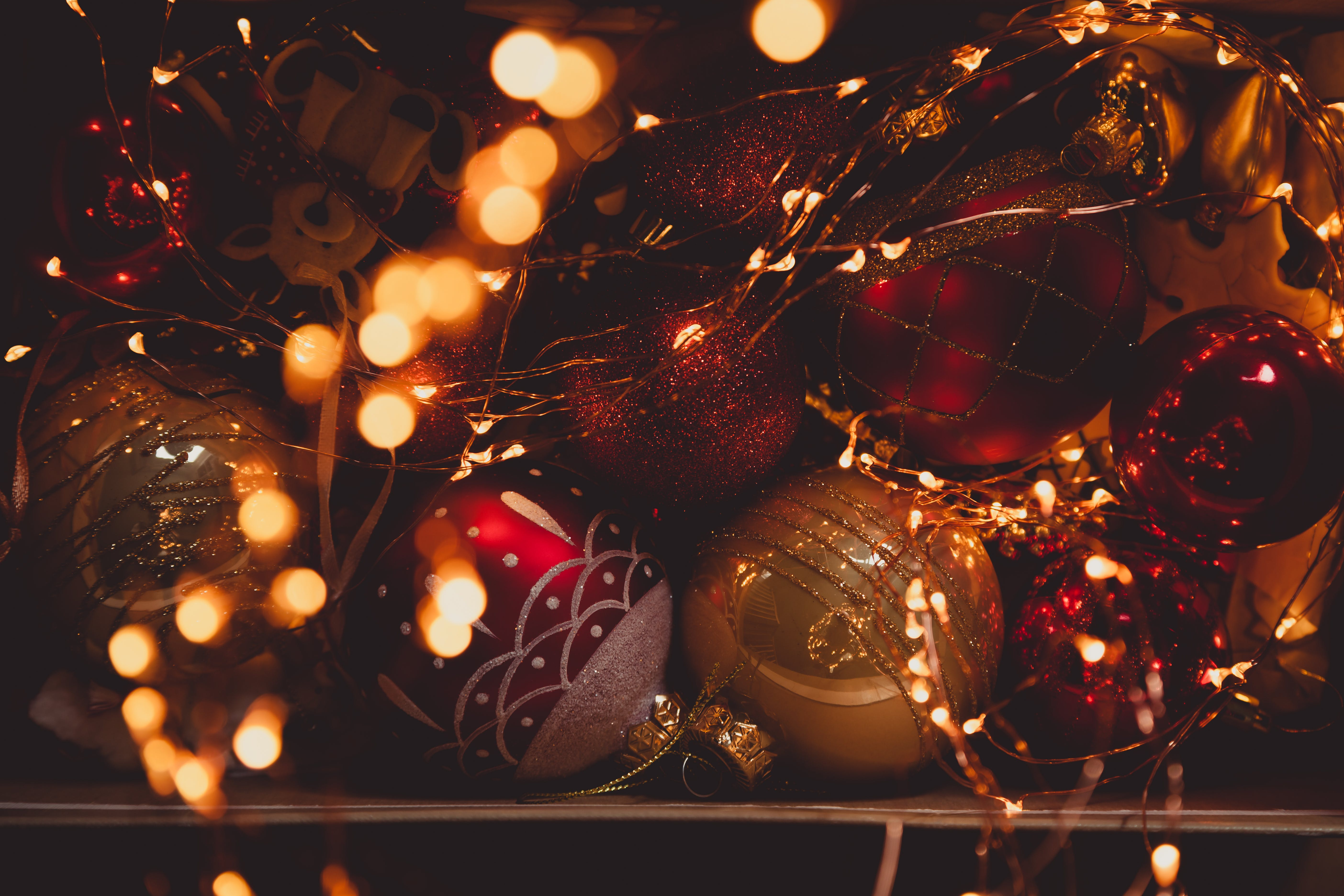 Selective Focus Photo of Baubles and Christmas Lights