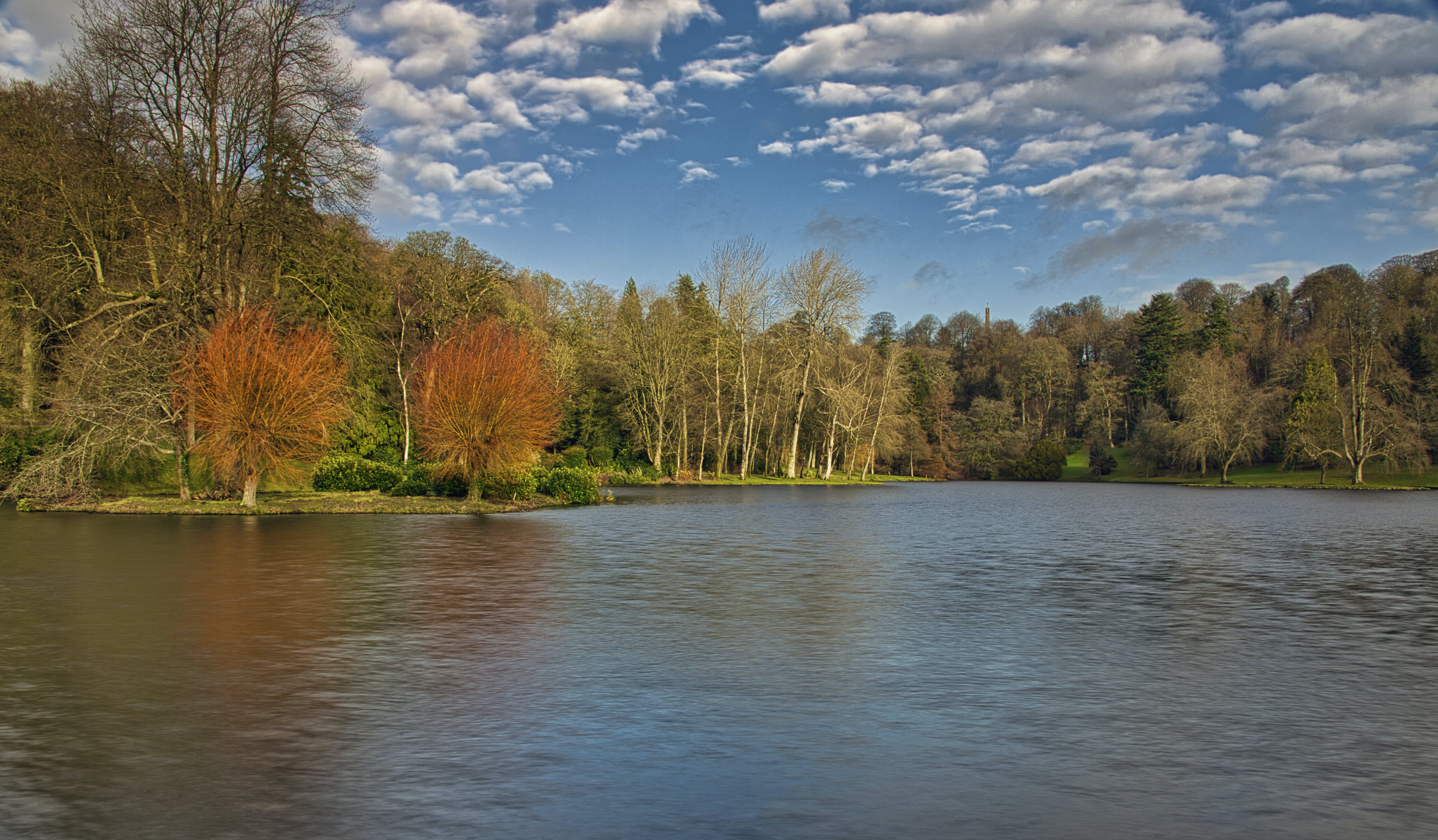 Free stock photo of autumn colours, blue sky, body of water, clouds
