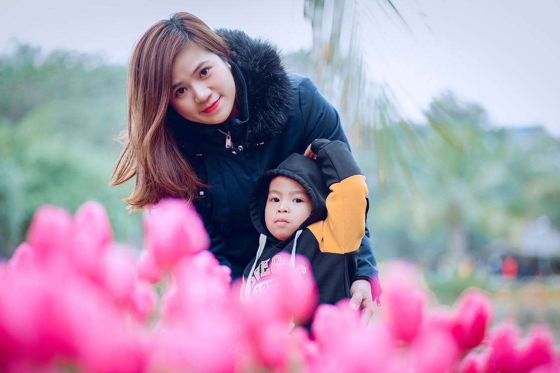 Woman Hugging Child