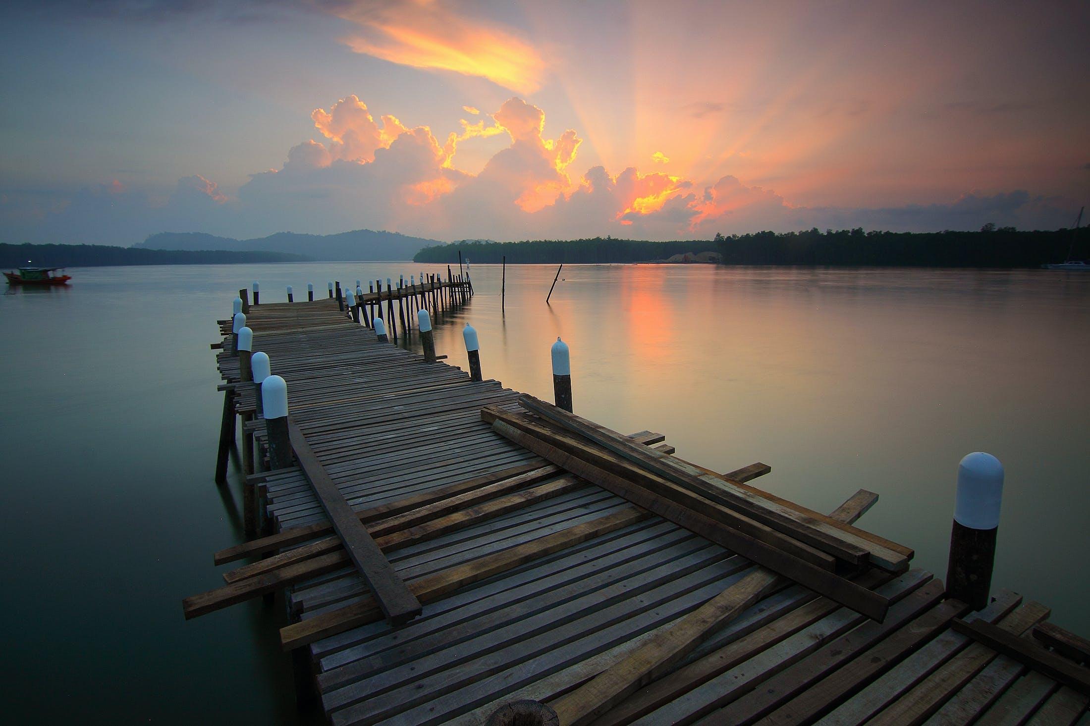 Foto profissional grátis de água, alvorecer, barco, céu