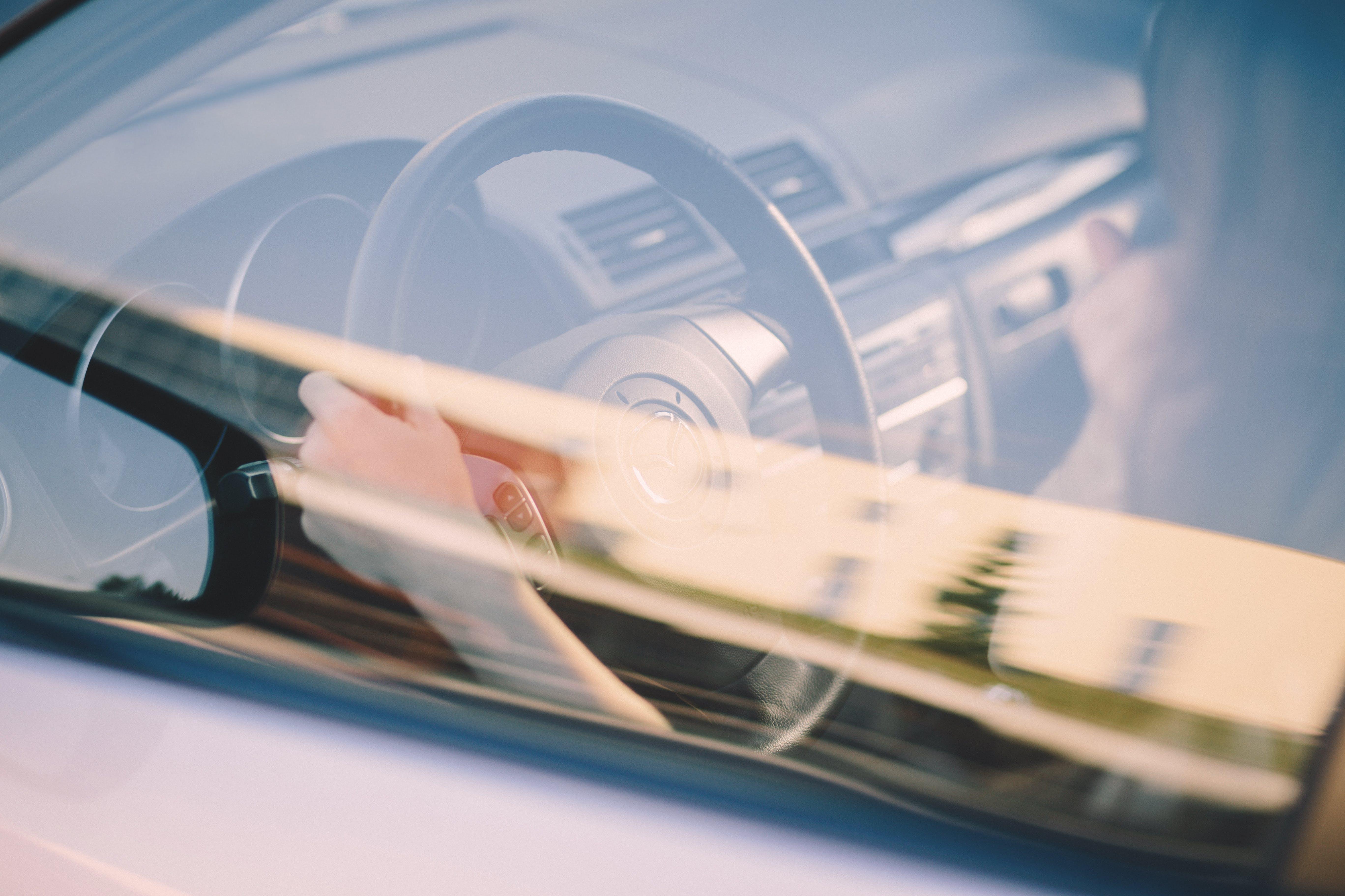 Steering Wheel Behind Vehicle Window