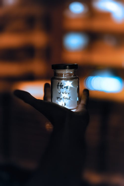 Selective Focus and Silhouette Photography of Jar \]